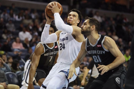 The Grizzlies' Dillon Brooks drives past Pistons guard Jose Calderon during their game Jan. 2 at FedExForum.