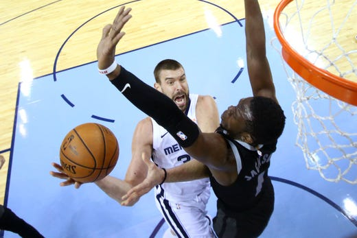 Memphis Grizzlies center Marc Gasol tries to lay the ball up past Detroit Pistons guard Reggie Jackson during their game at the FedExForum on Wednesday, January 2, 2019.