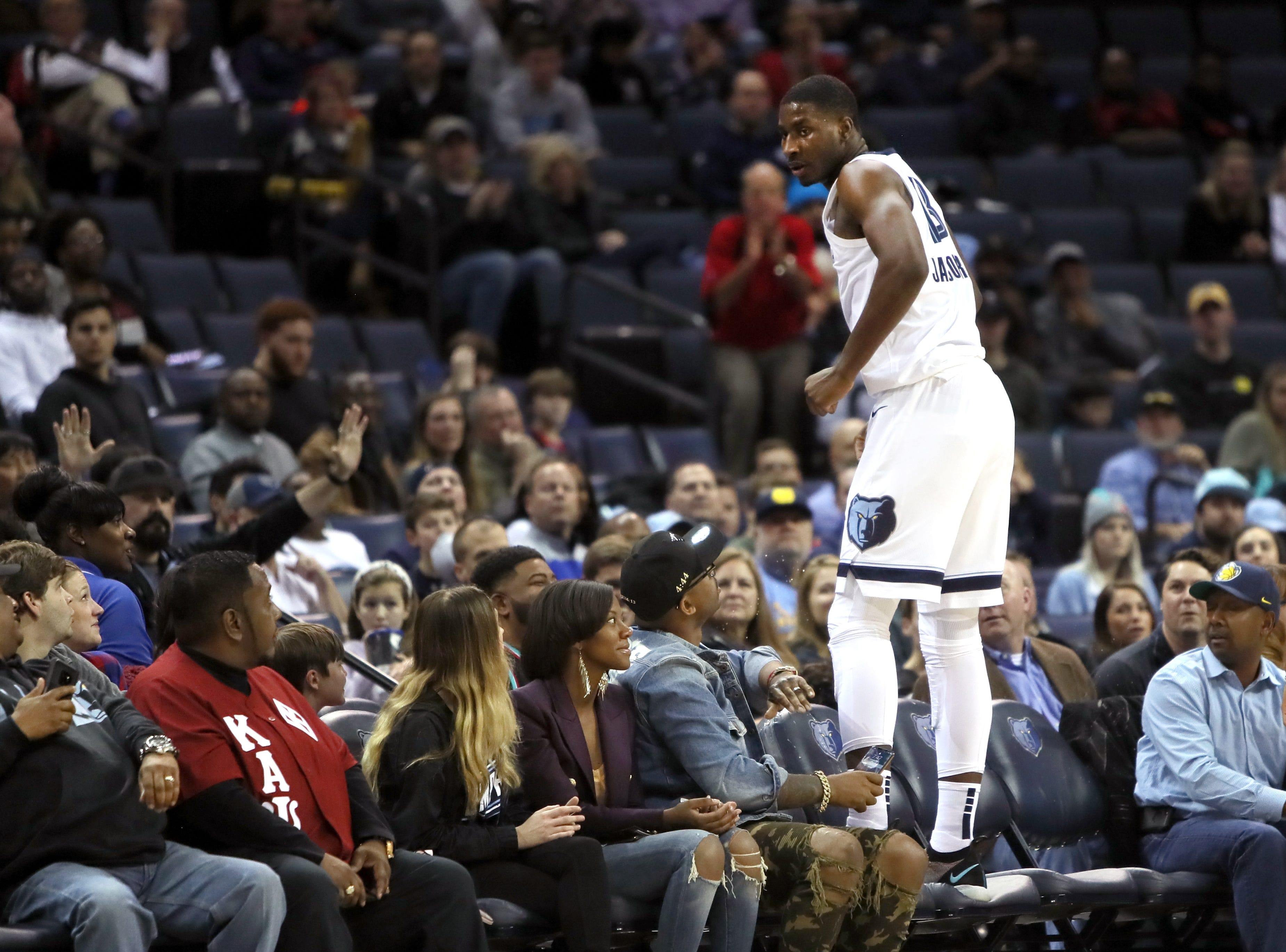 Memphis Grizzlies forward Jaren Jackson Jr. stands in the crowd after chasing down a lose ball against the Detroit Pistons during their game at the FedExForum on Wednesday, January 2, 2019.