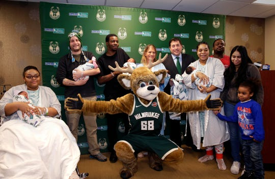 Milwaukee Bucks President Peter Feigin  joins Bango the Buck as they distribute baby blankets to newborns and their parents at Froedtert Hospital.