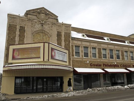 The historic former Garfield Theatre could be converted into the new King Library branch, along with renovated commercial space, under a preliminary plan.