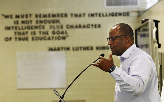 Reggie Moore, head of Milwaukee's Office of Violence Prevention, speaks in August at a meeting for SWIM, a collective of trauma-responsive social agencies, nonprofits, clinics and criminal justice officials. After he spoke, SWIM invited Moore to join its steering committee.