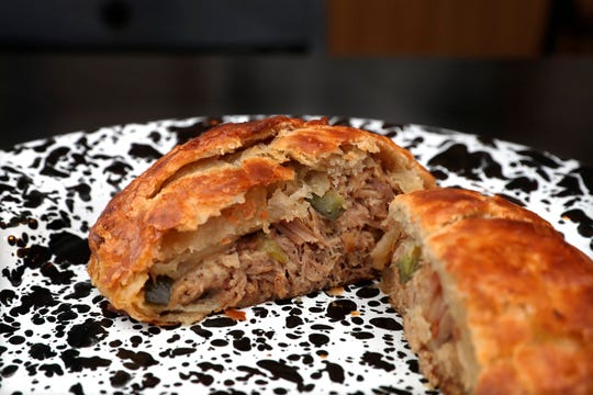 A pork Cuban savory hand pie at SmallPie has the flavors of a Cuban sandwich, with pickle and mustard.