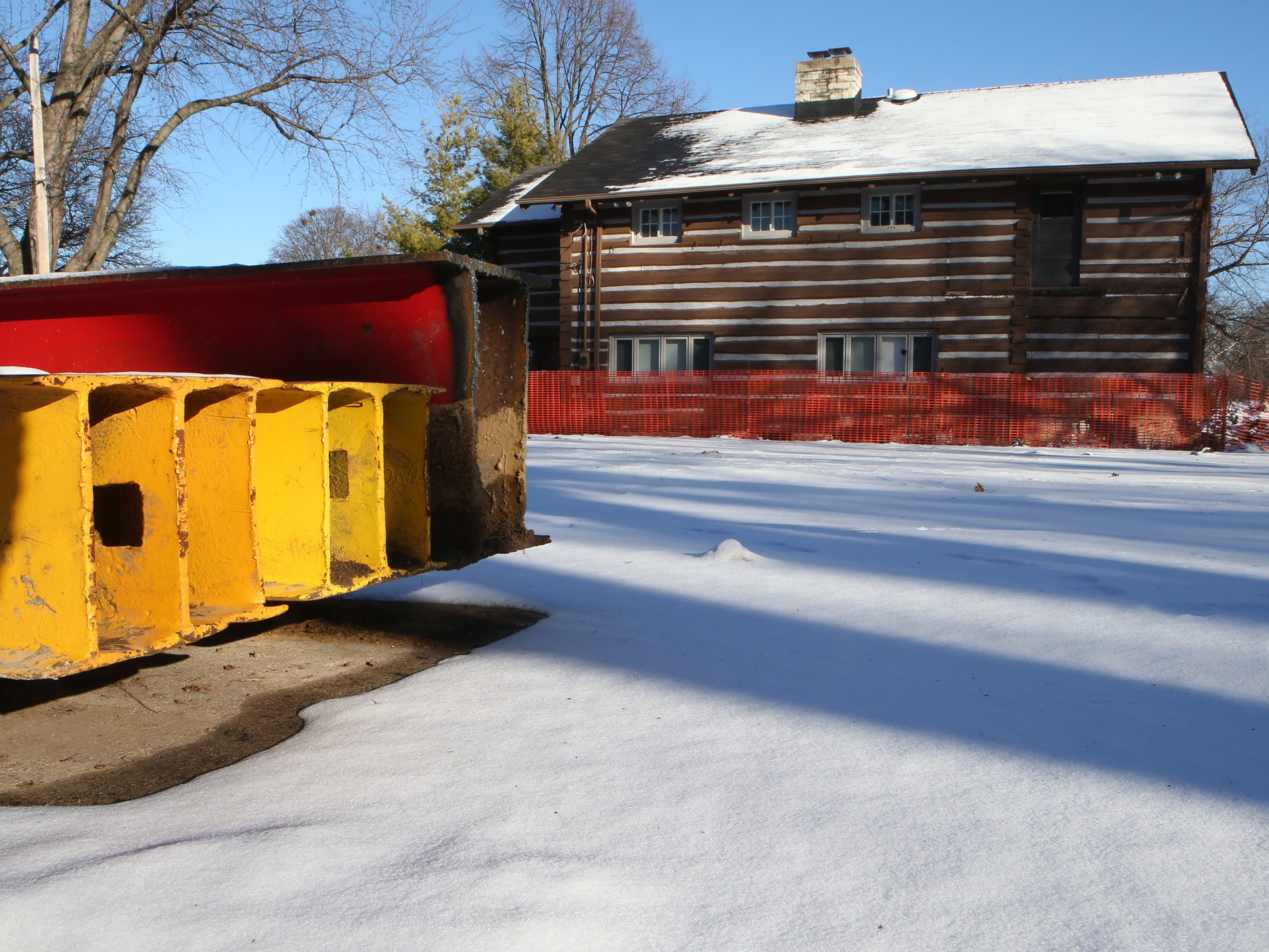 Steel beams wait to be placed beneath the beams, joists and foundation sill to lift the Log Cabin that is to be moved from 2515 N. Wauwatosa Ave. to a site on the northwest corner of North Avenue and 64th Street. A planned Jan. 9 move has been postponed.