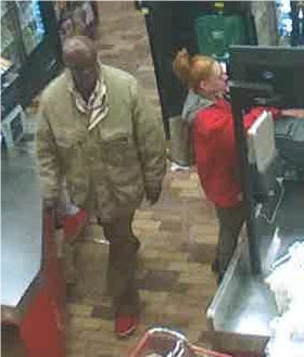 Menomonee Falls police are looking for a woman and man who took a cart load of merchandise from Wooman's grocery store.