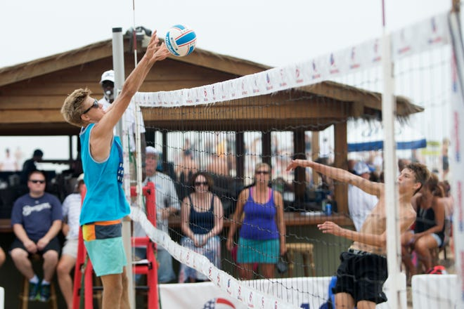 Tiki hut bars (background) and expanded volleyball competitions, like this USA Volleyball Junior Beach National Championships in 2016, were among the improvements at  Bradford Beach by an arm of the SURG restaurant group. The group no longer will operate concessions at Bradford Beach.