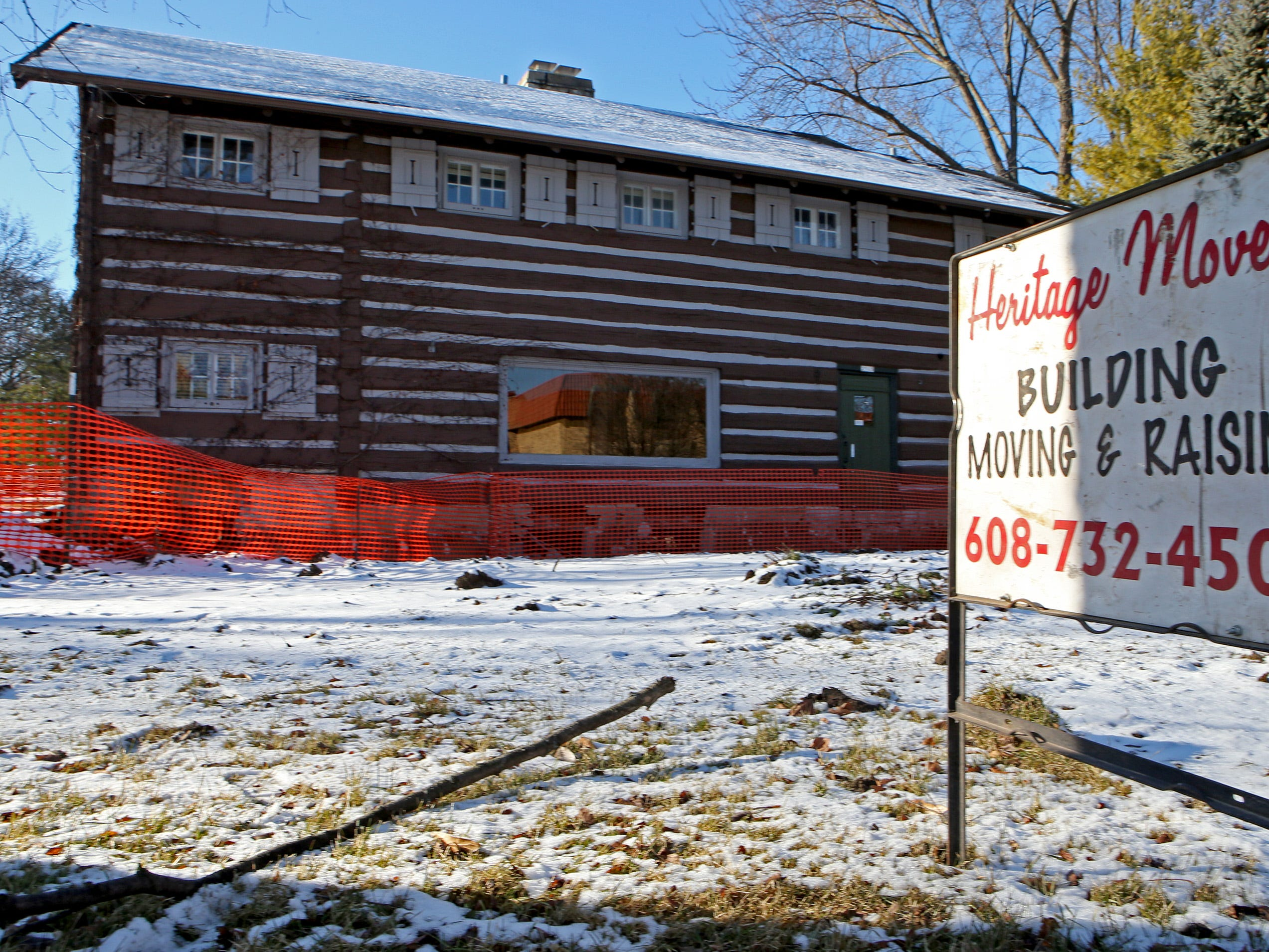 The Log Cabin at 2515 N. Wauwatosa Ave. is being prepared for a move to a site on the northwest corner of North Avenue and 64th Street. A planned Jan. 9 move has been postponed.