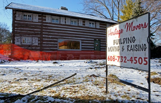 The log cabin at 2515 N. Wauwatosa Ave. is being prepared for a move to a site on the northwest corner of North Avenue and 64th Street. A new move date of March 13 was announced.