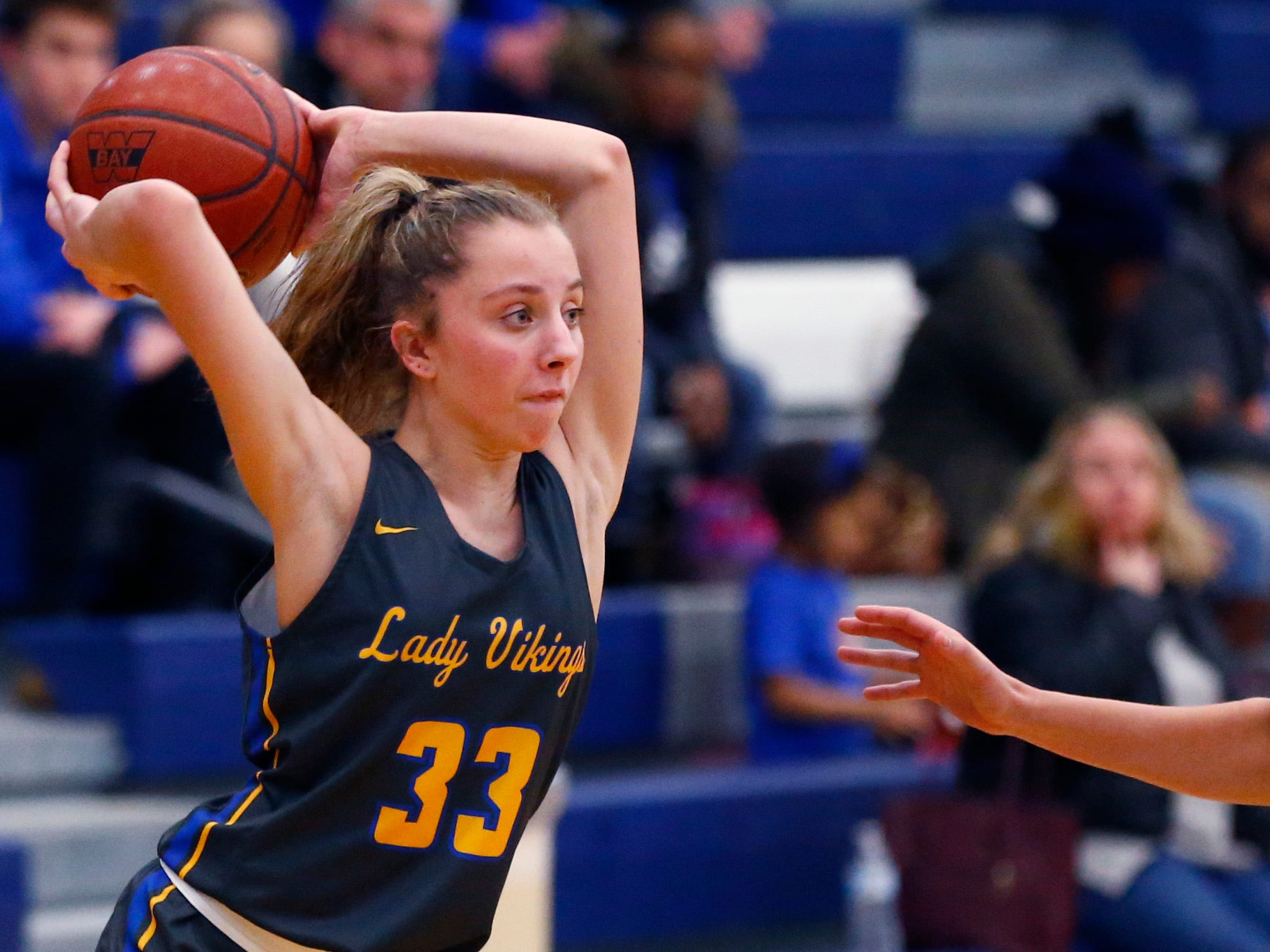 New Berlin West's Kayla Garny passes off the ball at Whitefish Bay on Jan. 2.