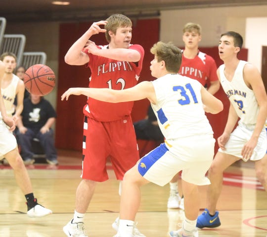 Flippin's Braden Hicks (12) has the ball knocked away by Bergman's A.J. Van Lear (31) on Wednesday at North Arkansas College.