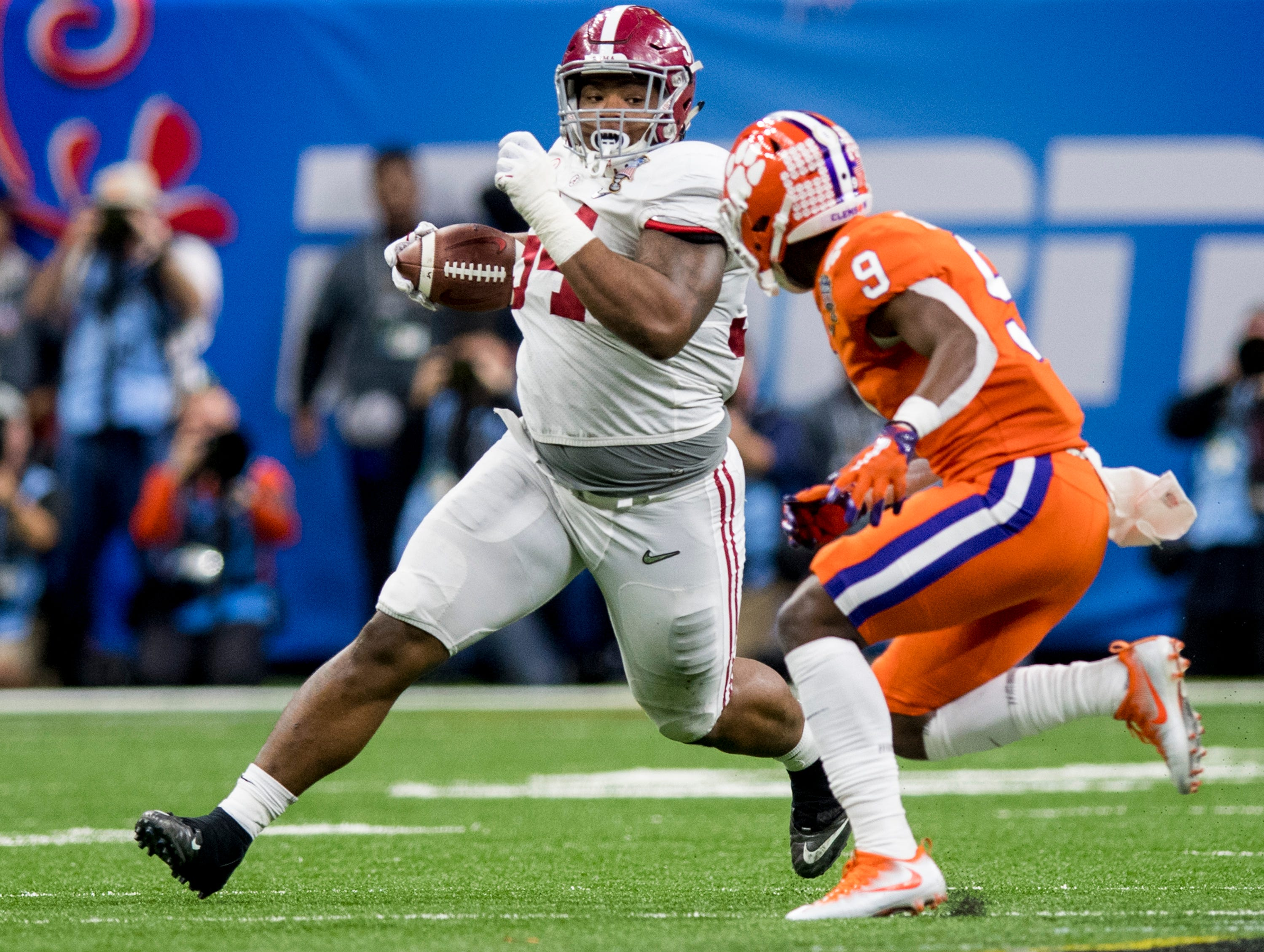 Alabama defensive lineman DaÕRon Payne (94) returns an interception against Clemson in the Sugar Bowl at the Superdome in New Orleans, La. on Monday January 1, 2018.