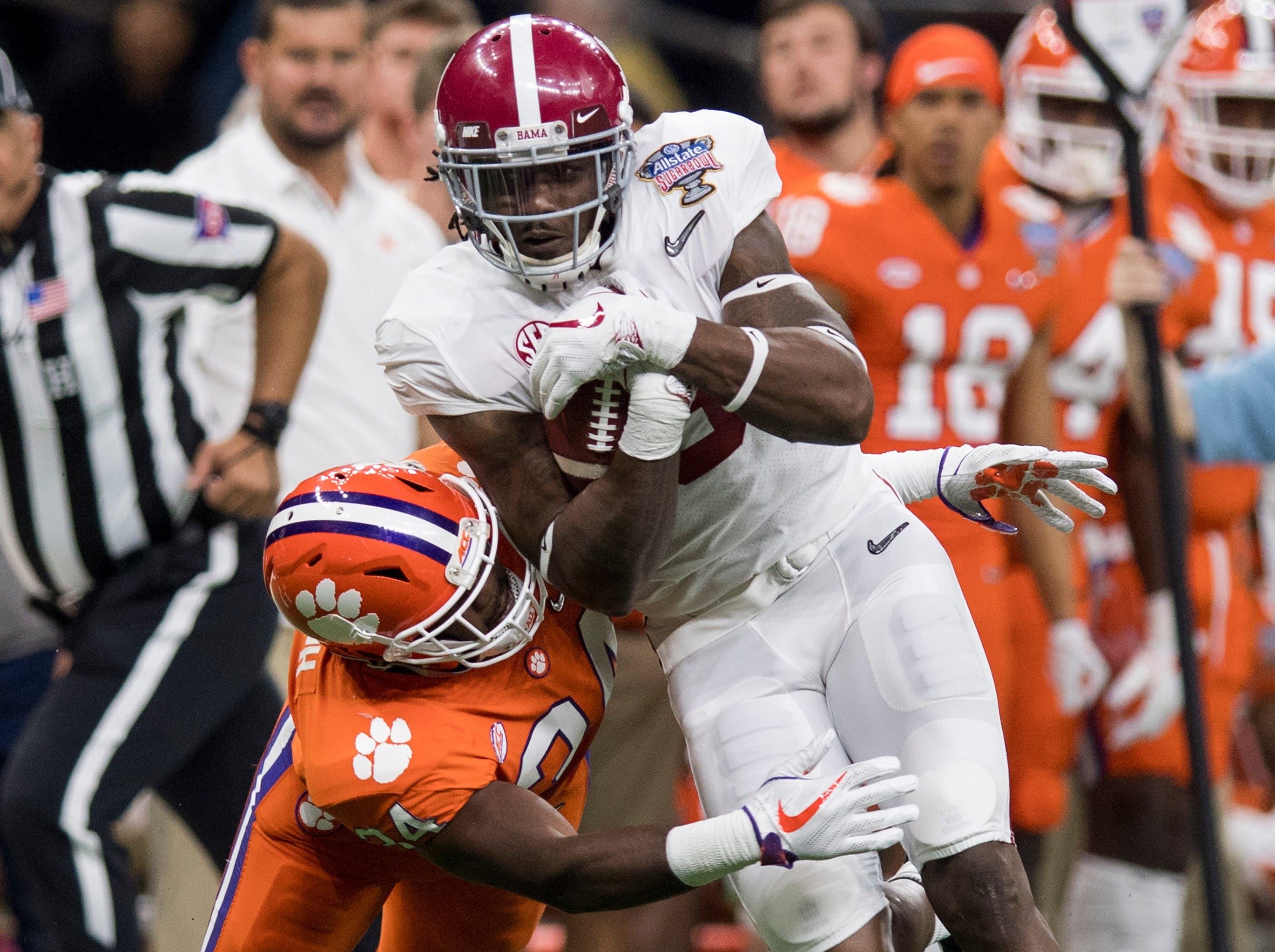 Alabama running back Bo Scarbrough (9) is defended by Clemson linebacker Kendall Joseph (34) in first half action in the Sugar Bowl at the Superdome in New Orleans, La. on Monday January 1, 2018.