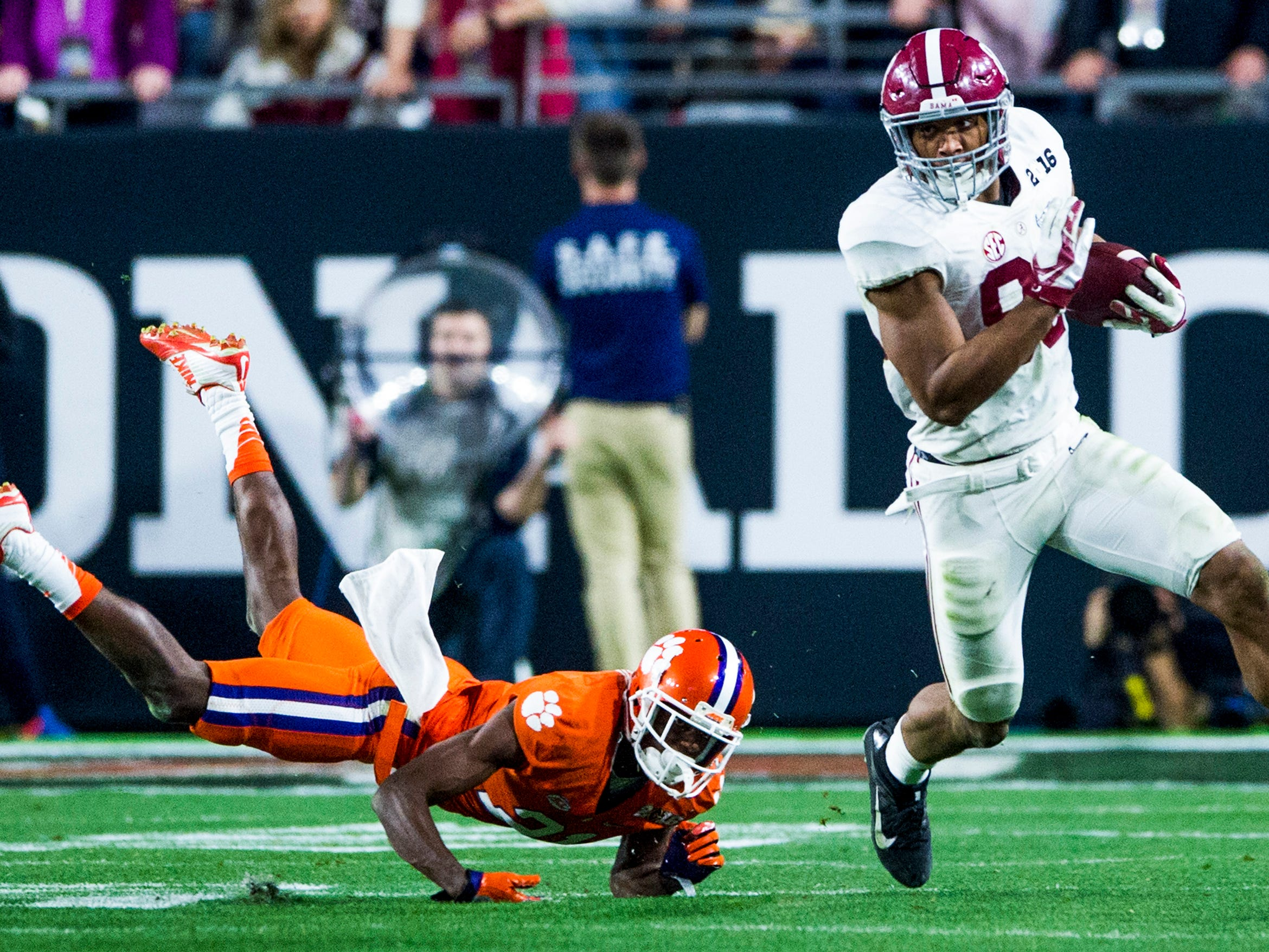 Alabama tight end O.J. Howard (88) gets by Clemson cornerback Adrian Baker (21) in the College Football Playoff Championship Game on Monday January 11, 2016 at University of Phoenix Stadium in Glendale, Az.