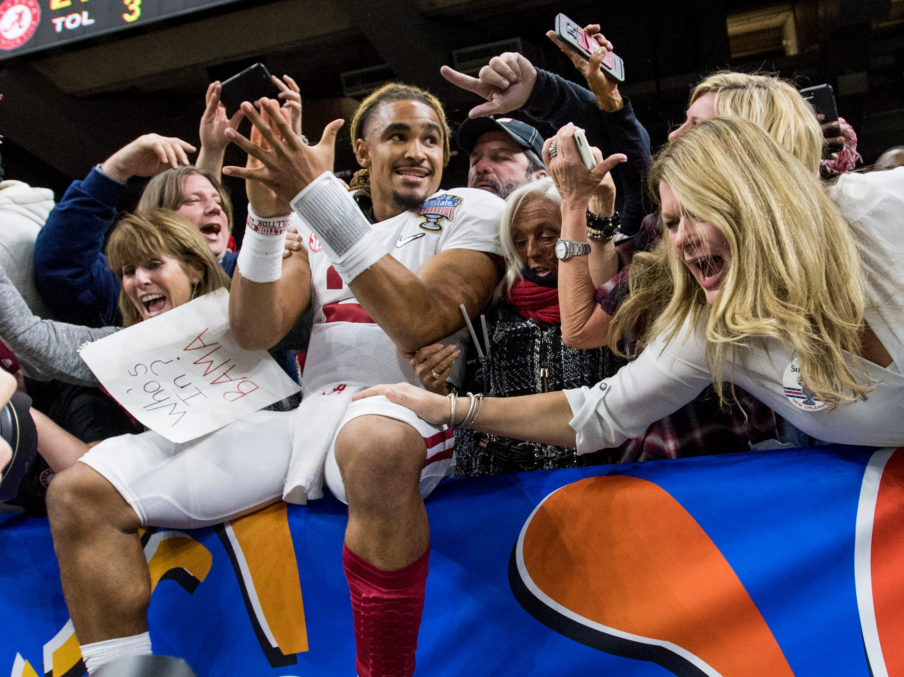 Alabama quarterback Jalen Hurts (2) celebrates with fans in the stands after defeating Clemson in the Sugar Bowl at the Superdome in New Orleans, La. on Monday January 1, 2018.