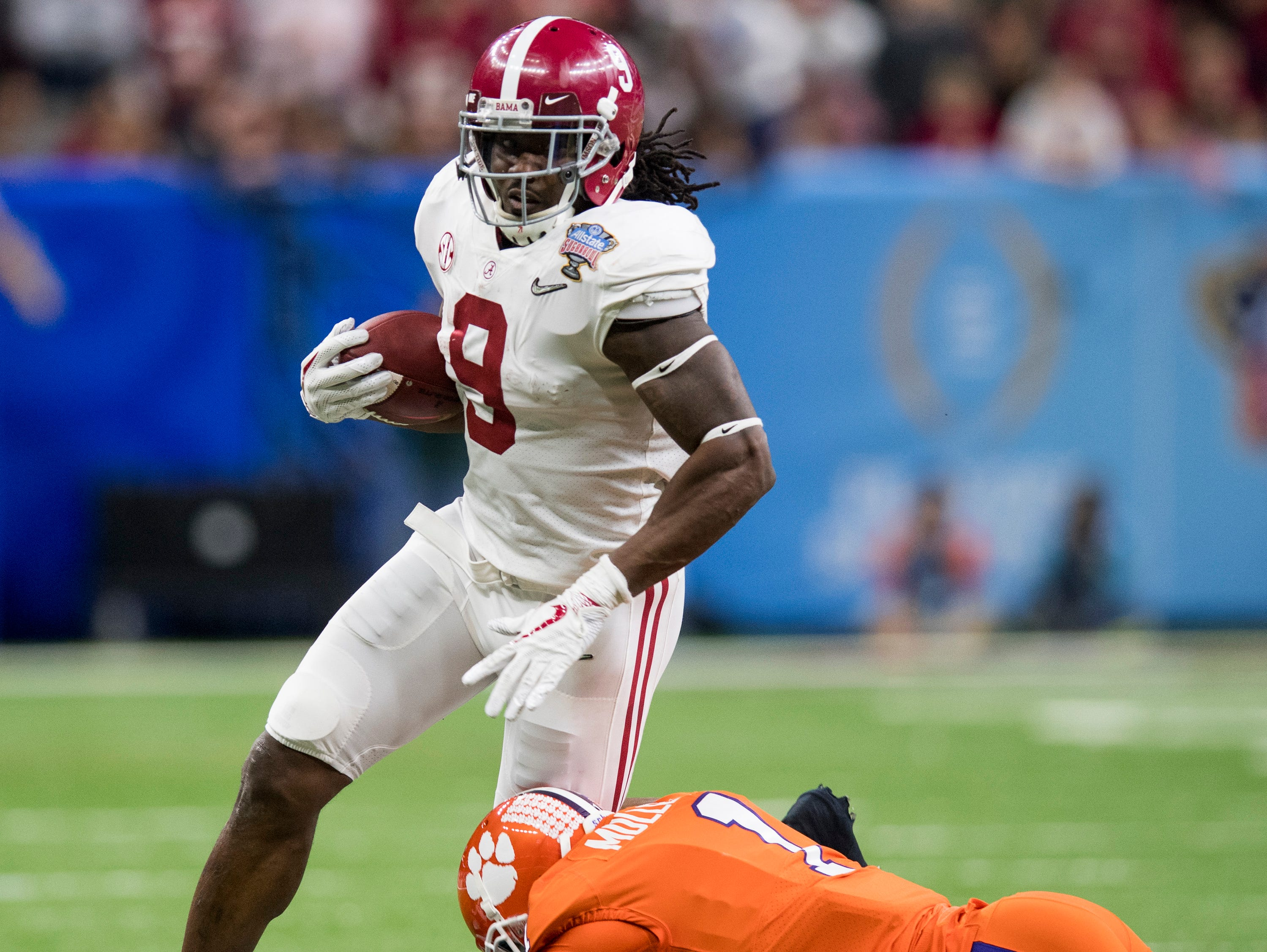 Alabama running back Bo Scarbrough (9) gets by Clemson corner back Trayvon Mullen (1) in first half action in the Sugar Bowl at the Superdome in New Orleans, La. on Monday January 1, 2018.