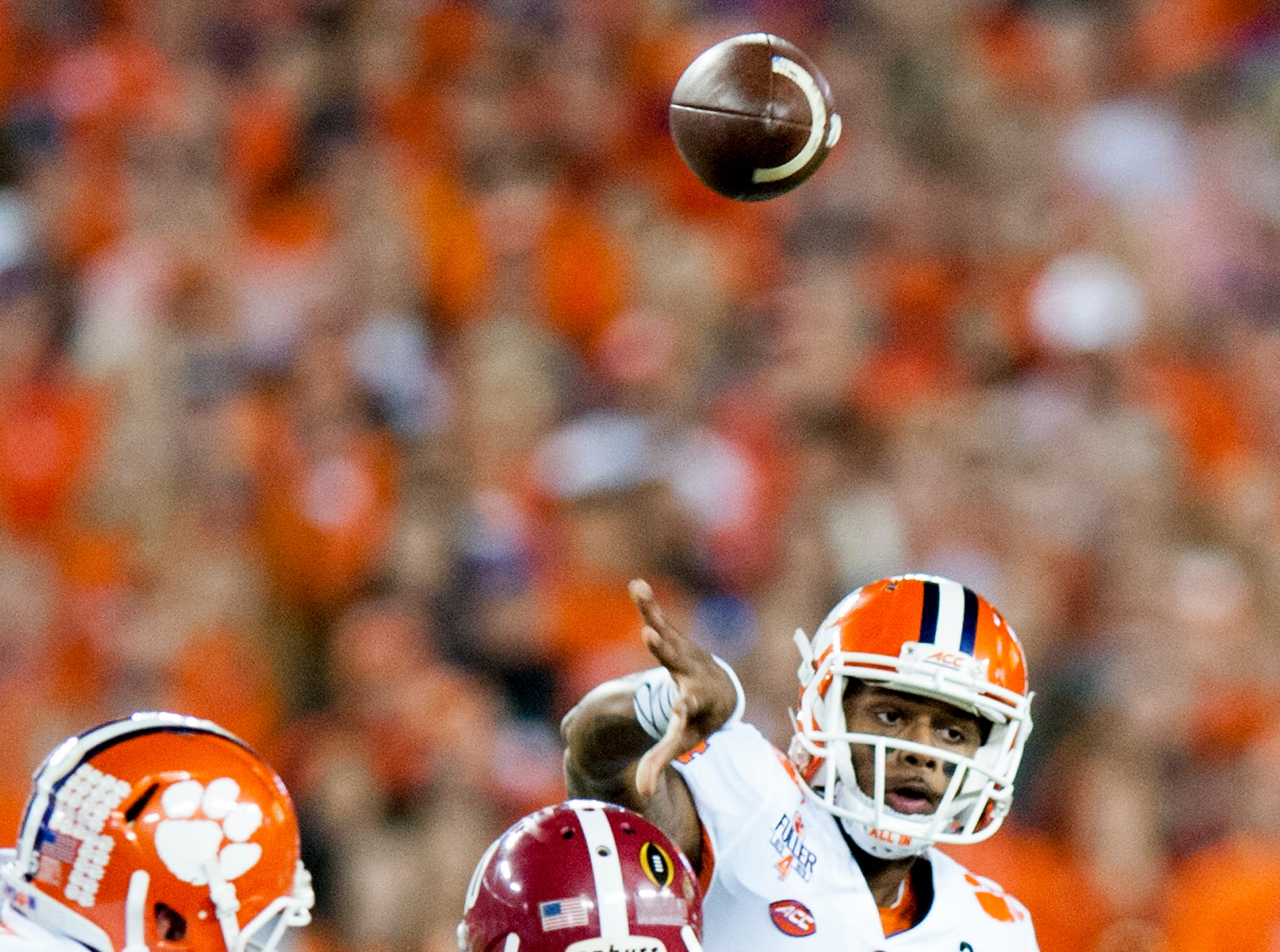 Clemson quarterback Deshaun Watson (4) throws against Alabama linebacker Reuben Foster (10) in first half action of the College Football Playoff National Championship Game at Raymond James Stadium in Tampa, Fla. on Monday January 9, 2017.