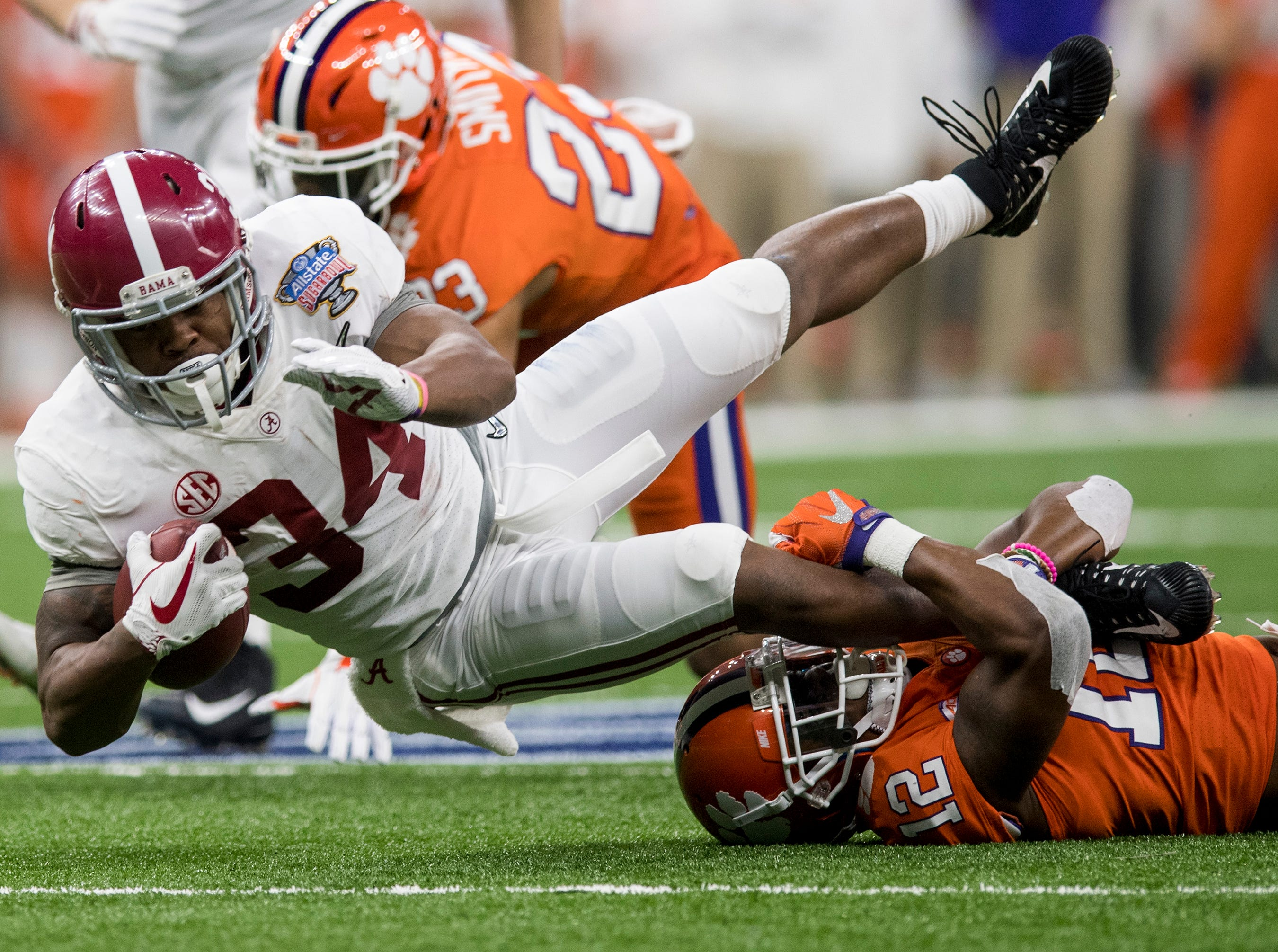 Clemson defensive back K'Von Wallace (12) stops Alabama running back Damien Harris (34) after a big gain in first half action in the Sugar Bowl at the Superdome in New Orleans, La. on Monday January 1, 2018.