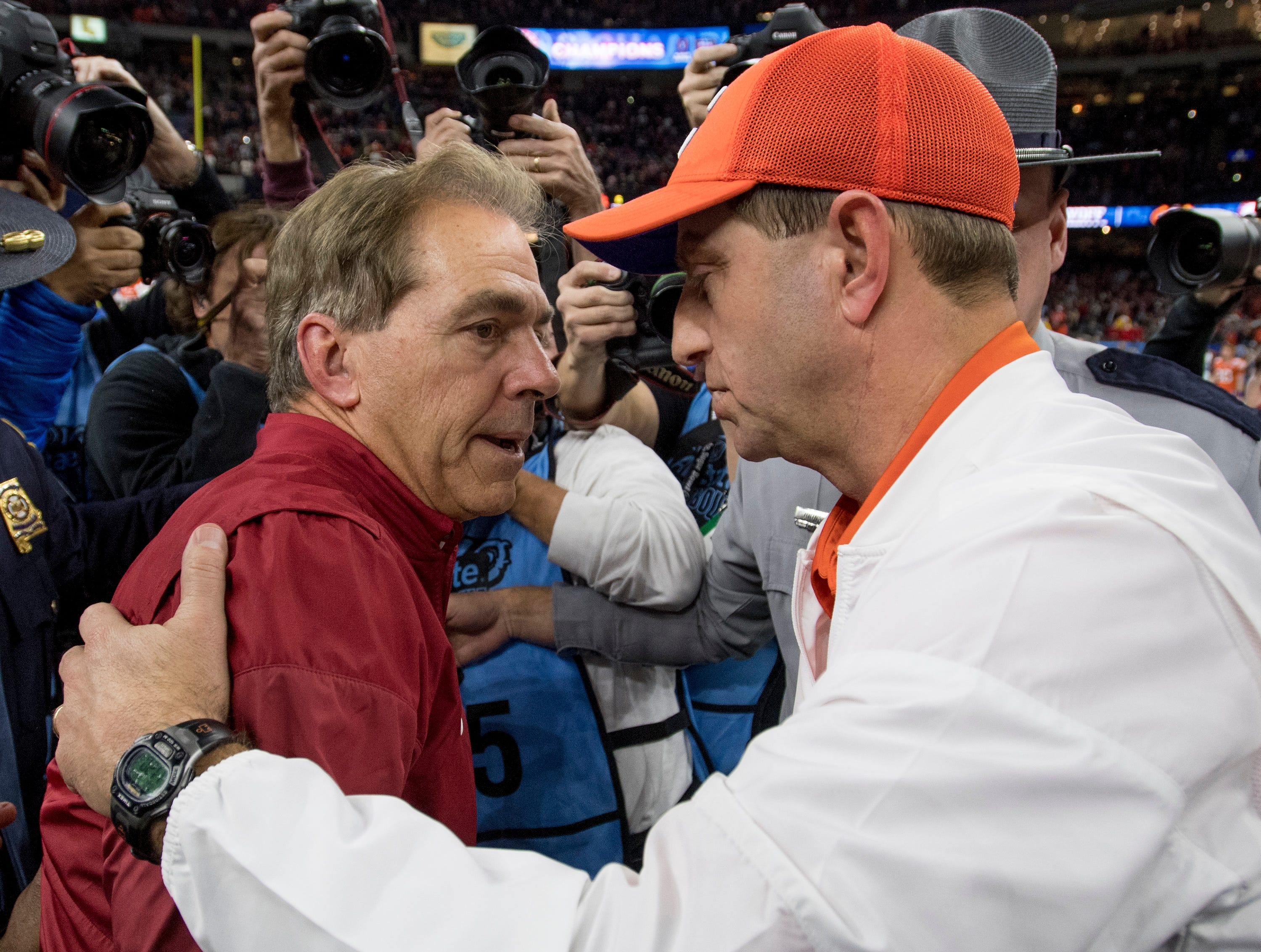 Alabama head coach Nick Saban and Clemson head coach Dabo Swinney  meet at midfield after the Sugar Bowl at the Superdome in New Orleans, La. on Monday January 1, 2018.