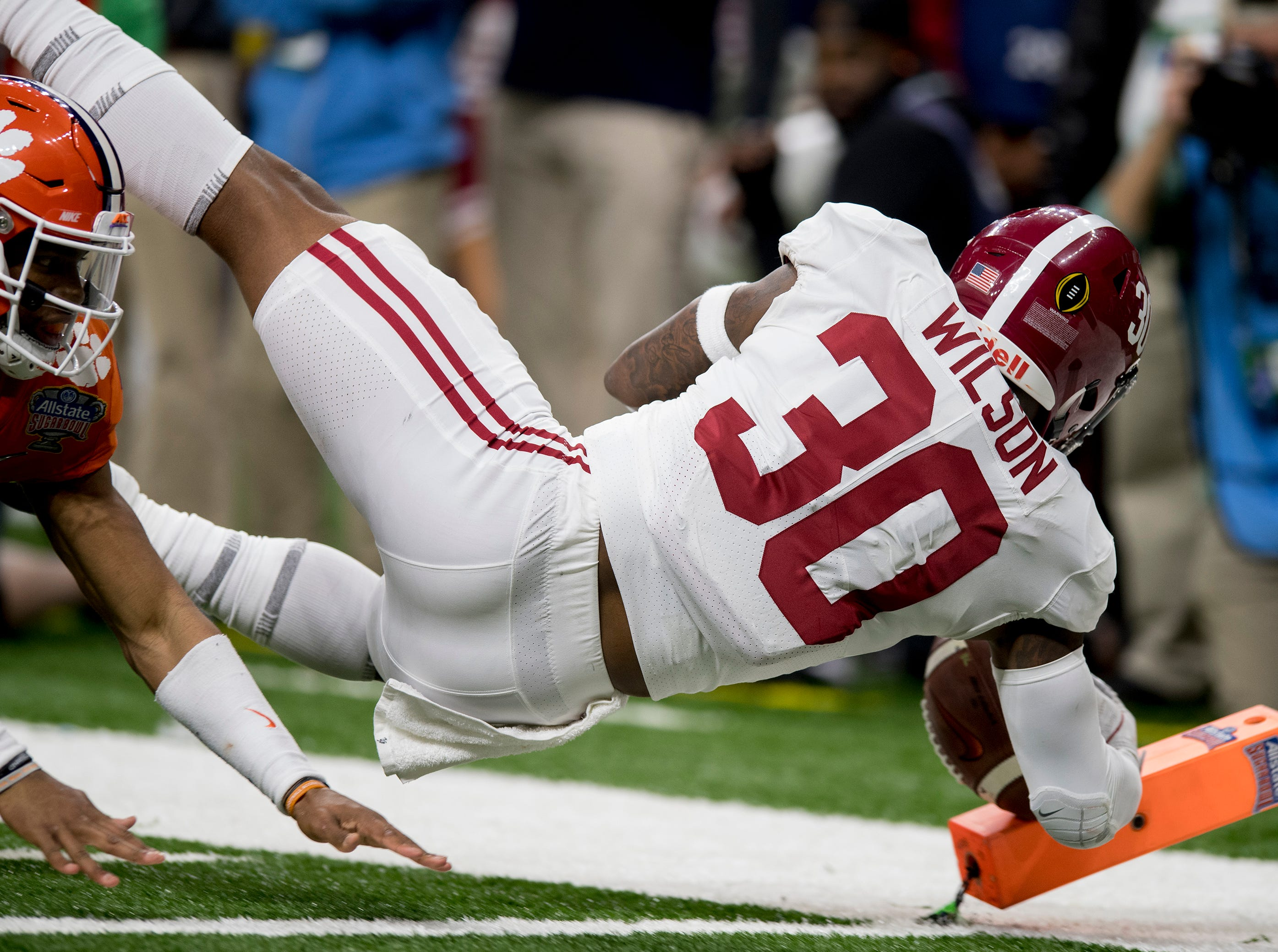 Alabama linebacker Mack Wilson (30) dives in for an touchdown on an interception against Clemson in the Sugar Bowl at the Superdome in New Orleans, La. on Monday January 1, 2018.