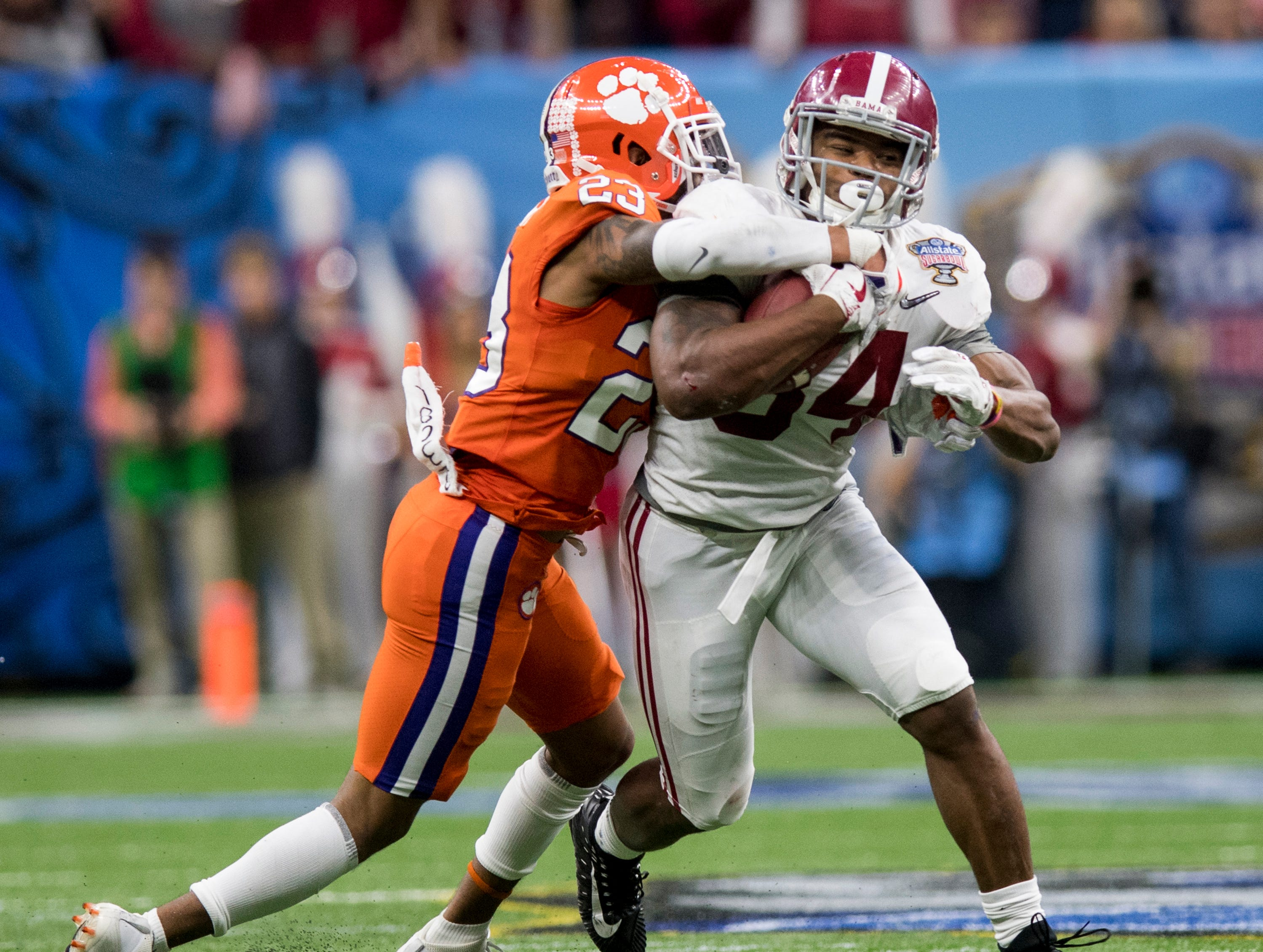 Clemson safety Van Smith (23) stops Alabama running back Damien Harris (34) in first half action in the Sugar Bowl at the Superdome in New Orleans, La. on Monday January 1, 2018.