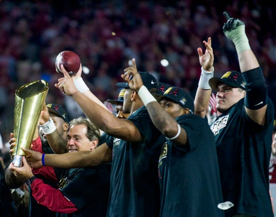 Alabama head coach Nick Saban lifts the championship trophy following the College Football Playoff Championship Game on Monday January 11, 2016 at University of Phoenix Stadium in Glendale, Az.