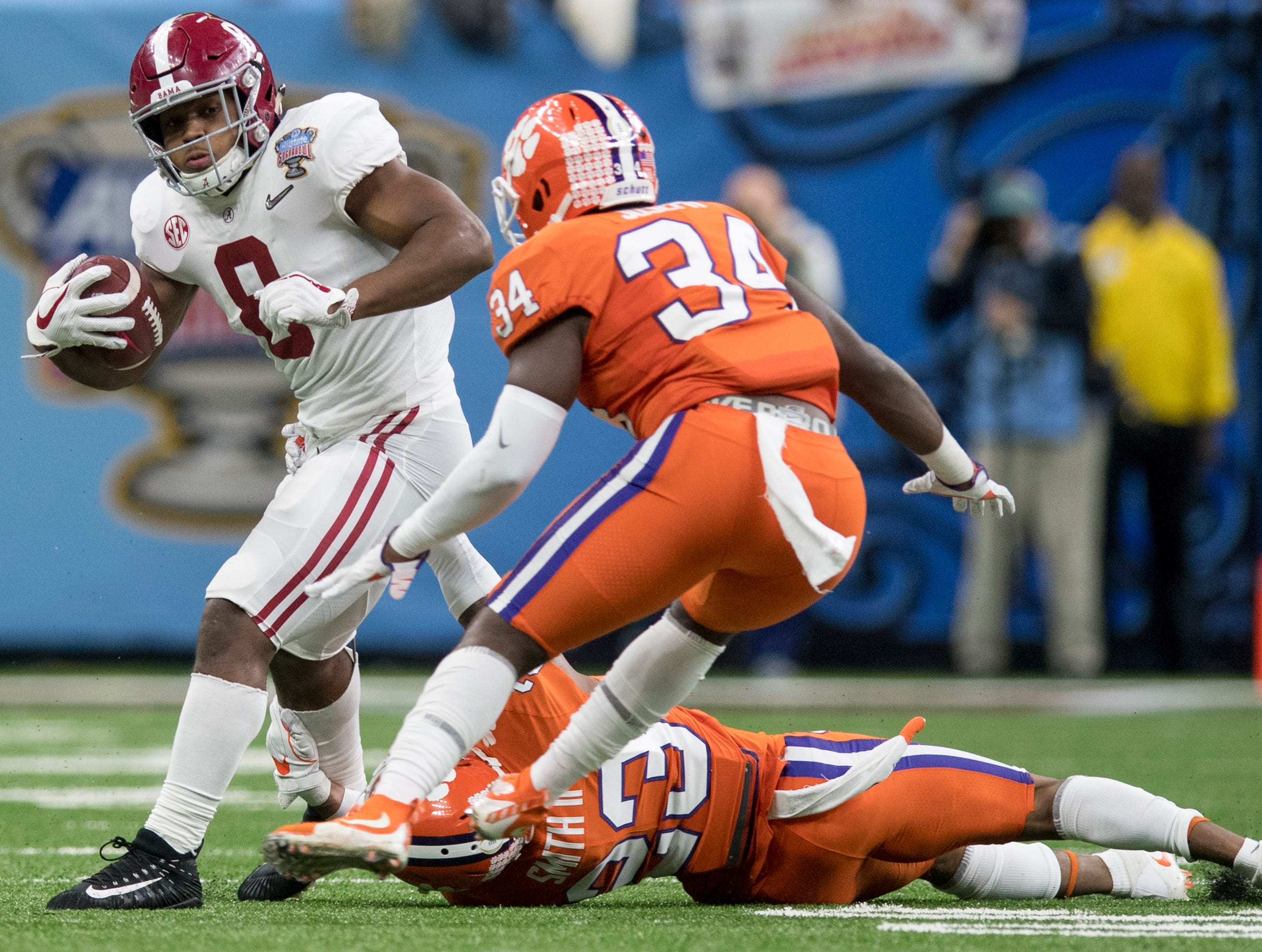Alabama running back Josh Jacobs (8) carries against Clemson in first half action in the Sugar Bowl at the Superdome in New Orleans, La. on Monday January 1, 2018.