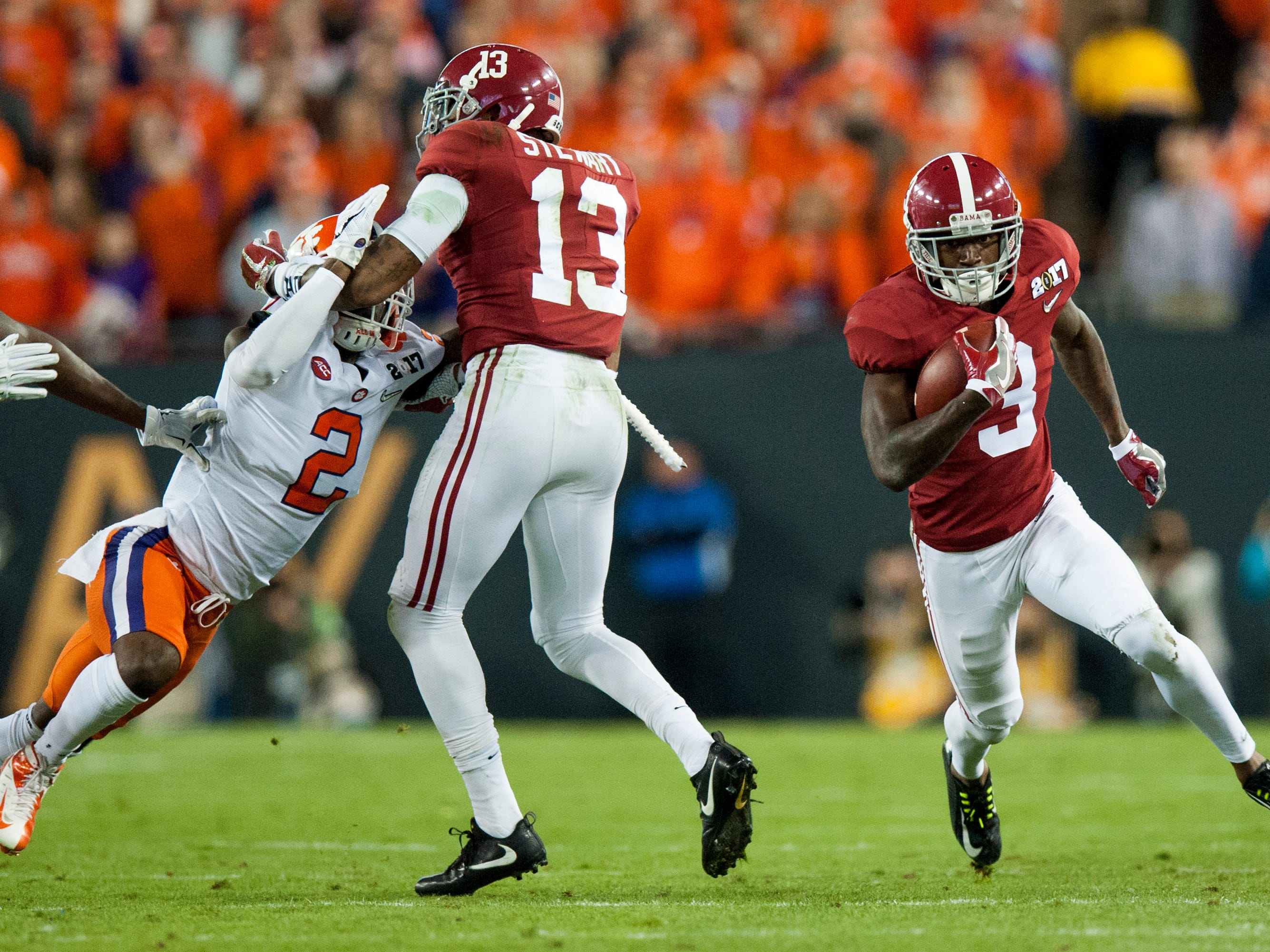 Alabama wide receiver Calvin Ridley (3) runs with a reception behind the blocking of Alabama wide receiver ArDarius Stewart (13) in first half action of the College Football Playoff National Championship Game at Raymond James Stadium in Tampa, Fla. on Monday January 9, 2017.