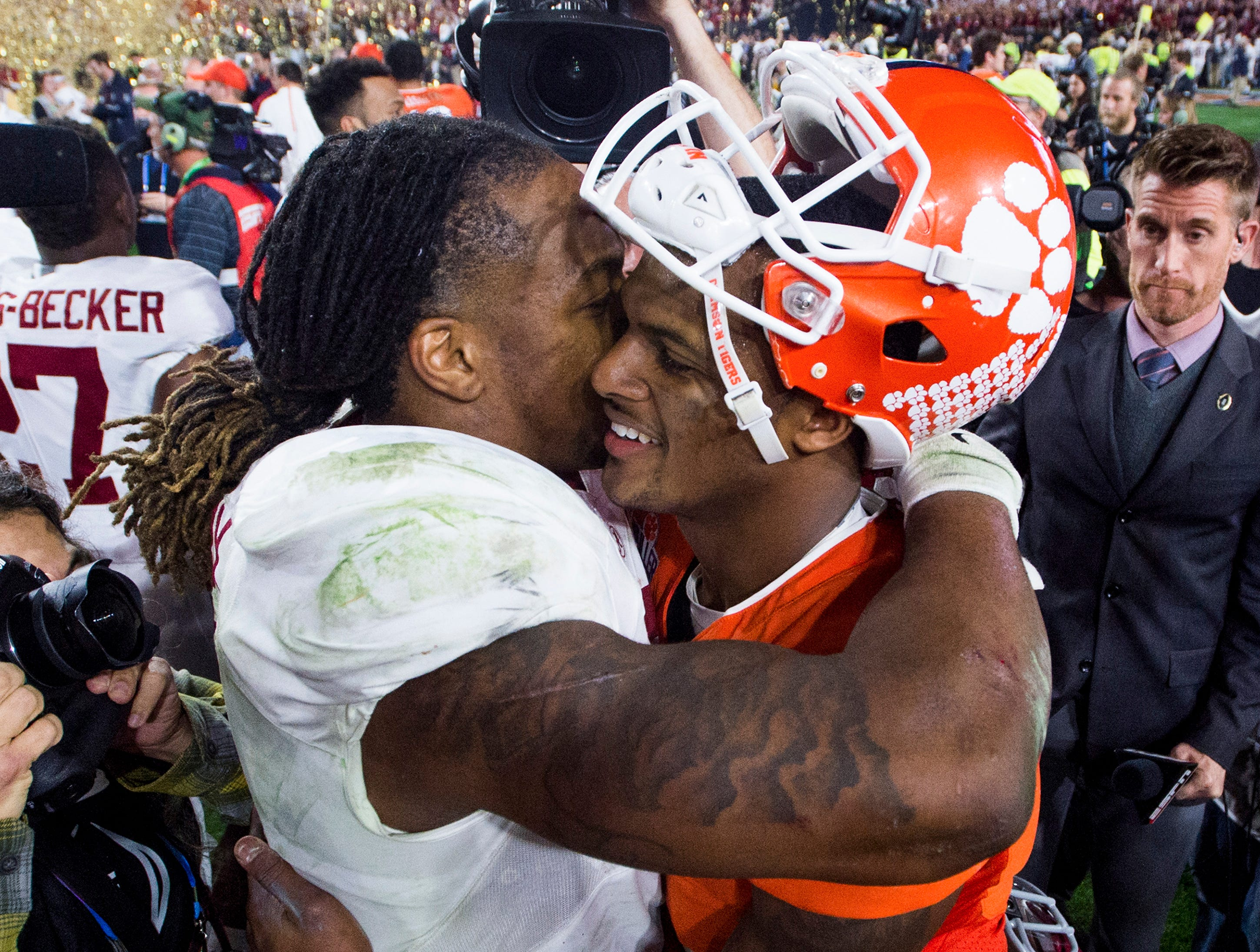 Alabama running back Derrick Henry (2) and Clemson quarterback Deshaun Watson (4)  hug following the College Football Playoff Championship Game on Monday January 11, 2016 at University of Phoenix Stadium in Glendale, Az.