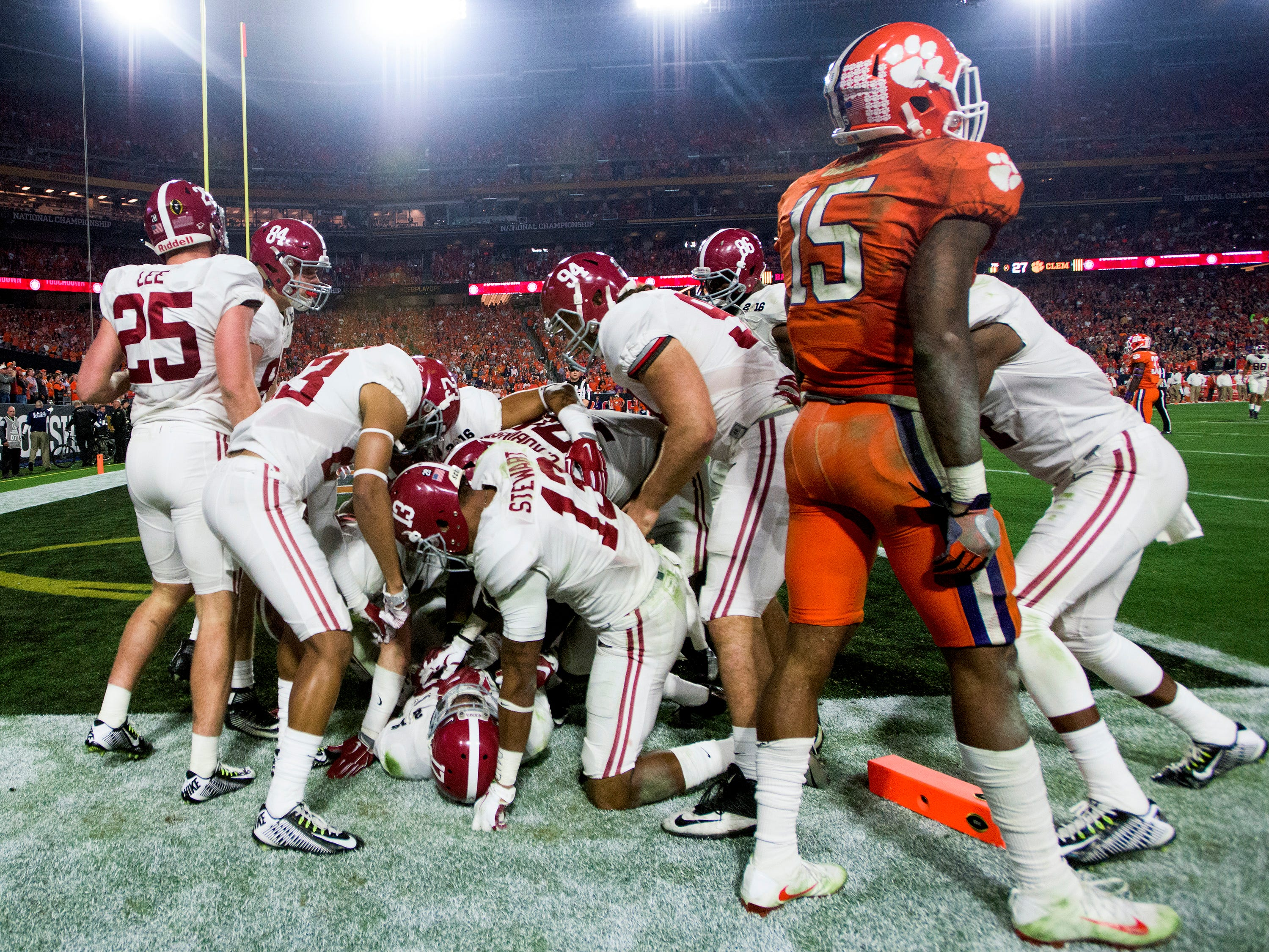 Alabama running back Kenyan Drake (17) is swarmed after returning a kick for a touchdown in the College Football Playoff Championship Game on Monday January 11, 2016 at University of Phoenix Stadium in Glendale, Az.
