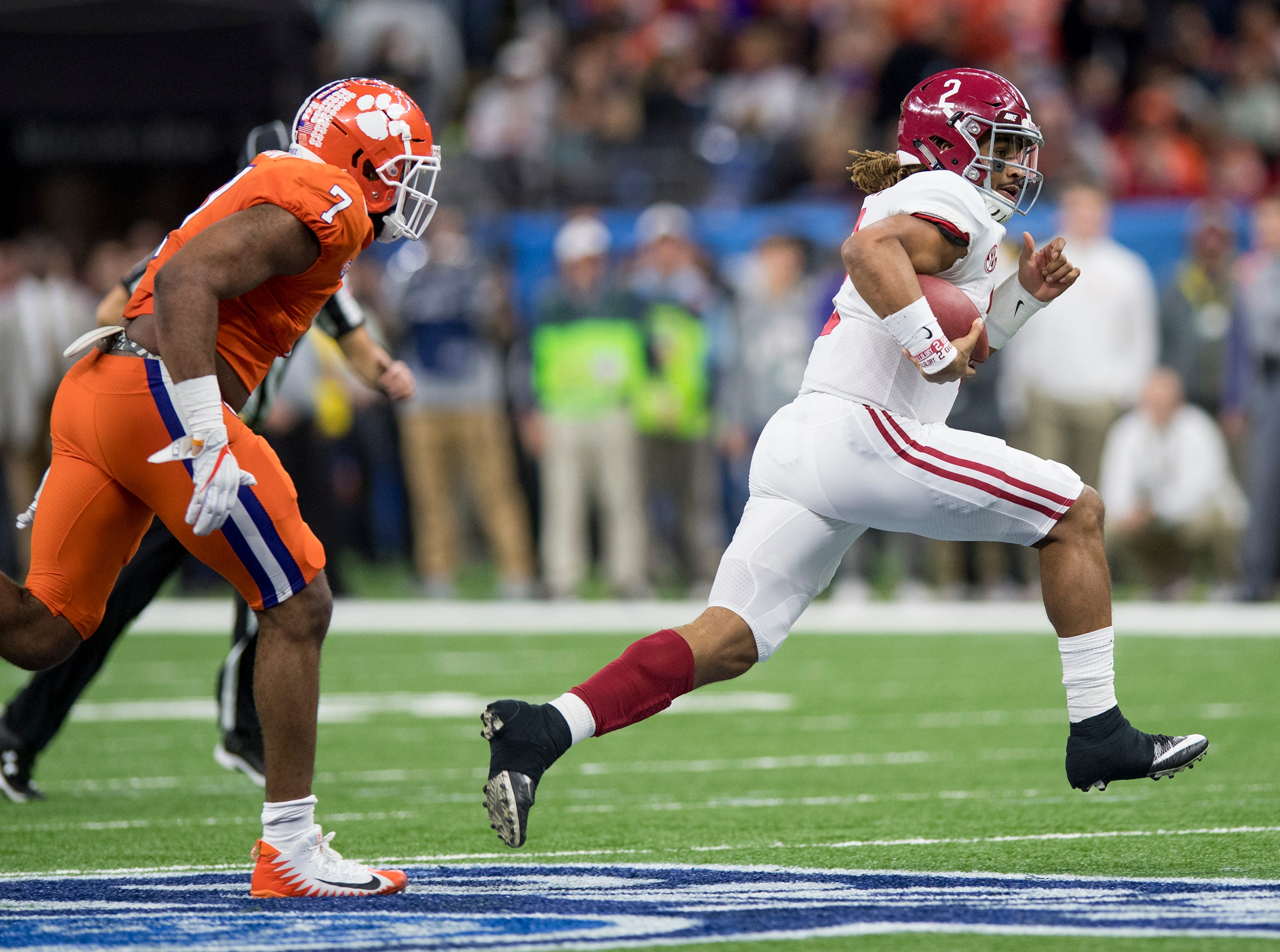 Alabama quarterback Jalen Hurts (2) carries against Clemson in first half action in the Sugar Bowl at the Superdome in New Orleans, La. on Monday January 1, 2018.