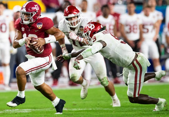 Alabama quarterback Tua Tagovailoa (13) carries the ball in first half action of the Orange Bowl at Hard Rock Stadium in Miami Gardens, Fla., on Saturday December 29, 2018.