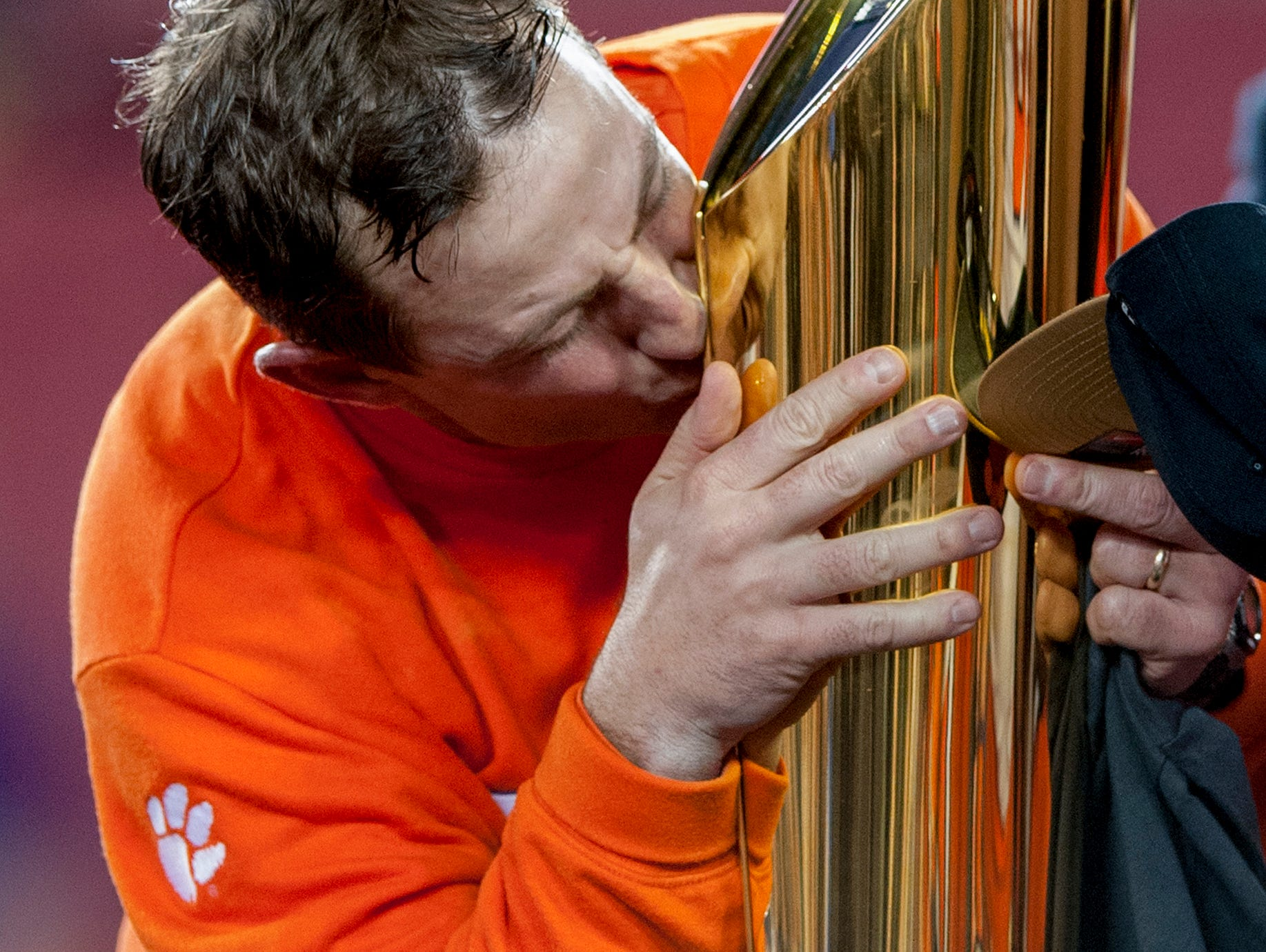 Clemson head coach Dabo Swinney kisses the National Championship Trophy after defeating Alabama in the College Football Playoff National Championship Game at Raymond James Stadium in Tampa, Fla. on Monday January 9, 2017.