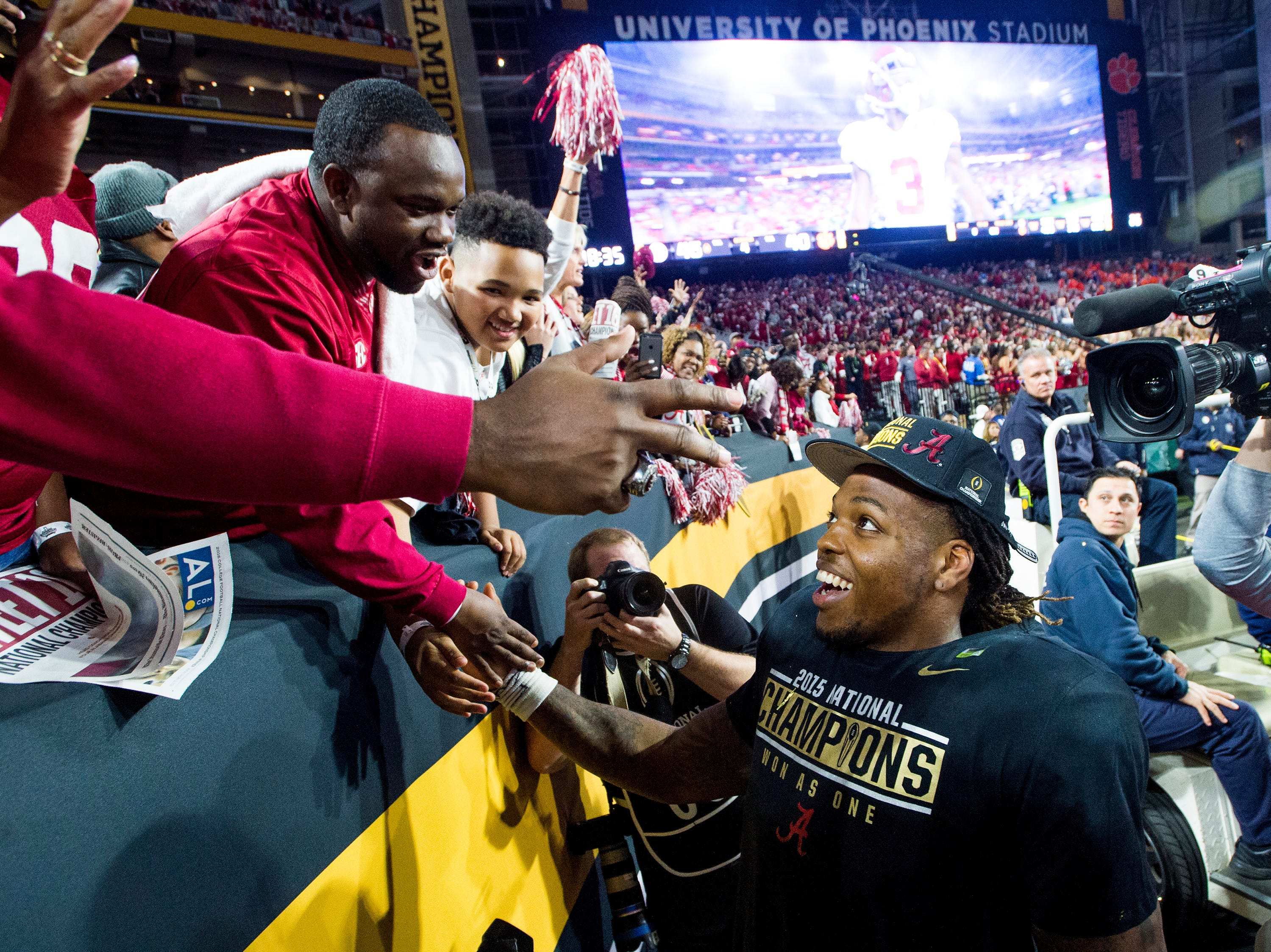 Alabama running back Derrick Henry (2) celebrates with fans in the College Football Playoff Championship Game on Monday January 11, 2016 at University of Phoenix Stadium in Glendale, Az.
