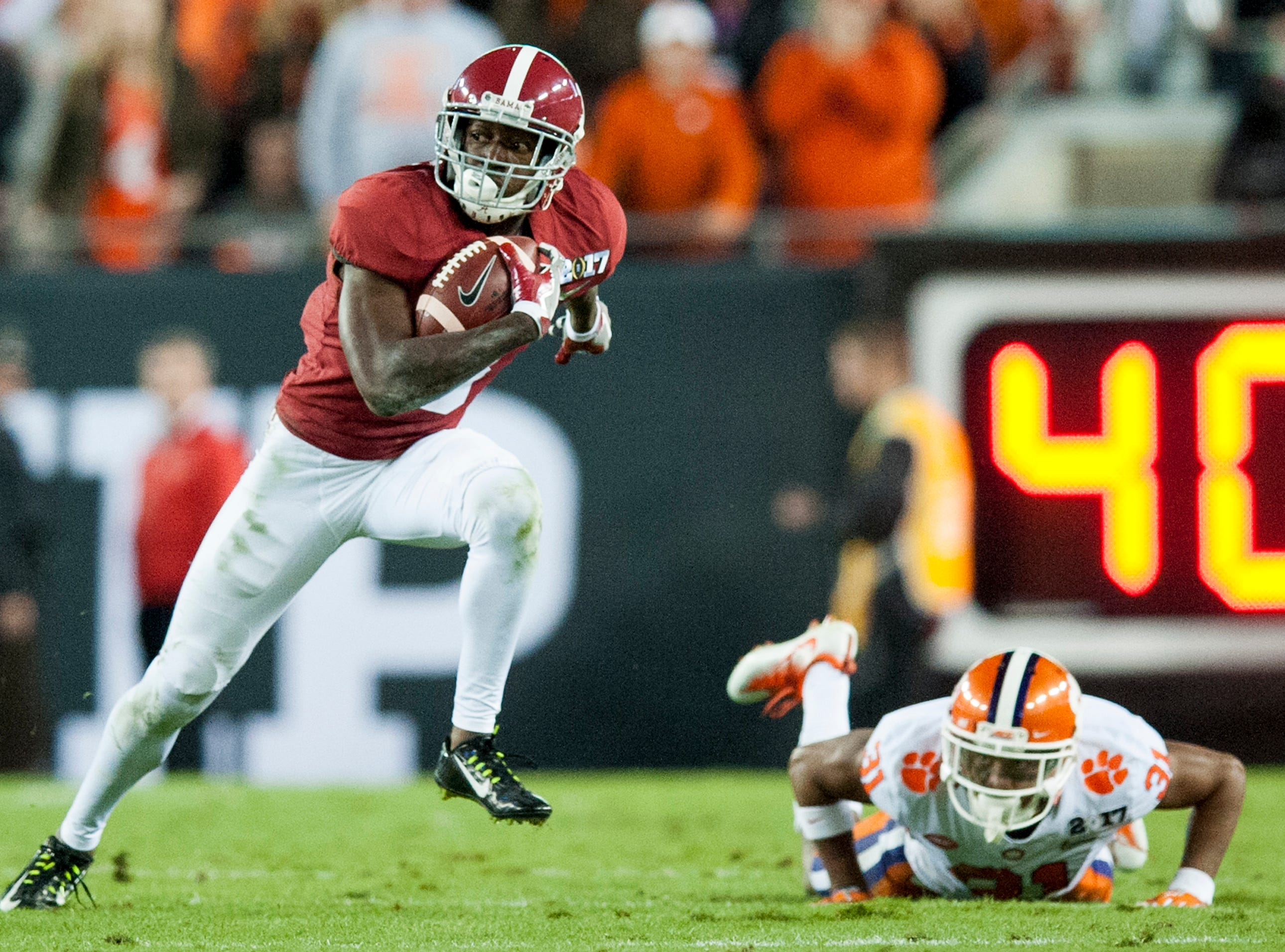 Alabama wide receiver Calvin Ridley (3) carries a reception against Clemson in first half action of the College Football Playoff National Championship Game at Raymond James Stadium in Tampa, Fla. on Monday January 9, 2017.