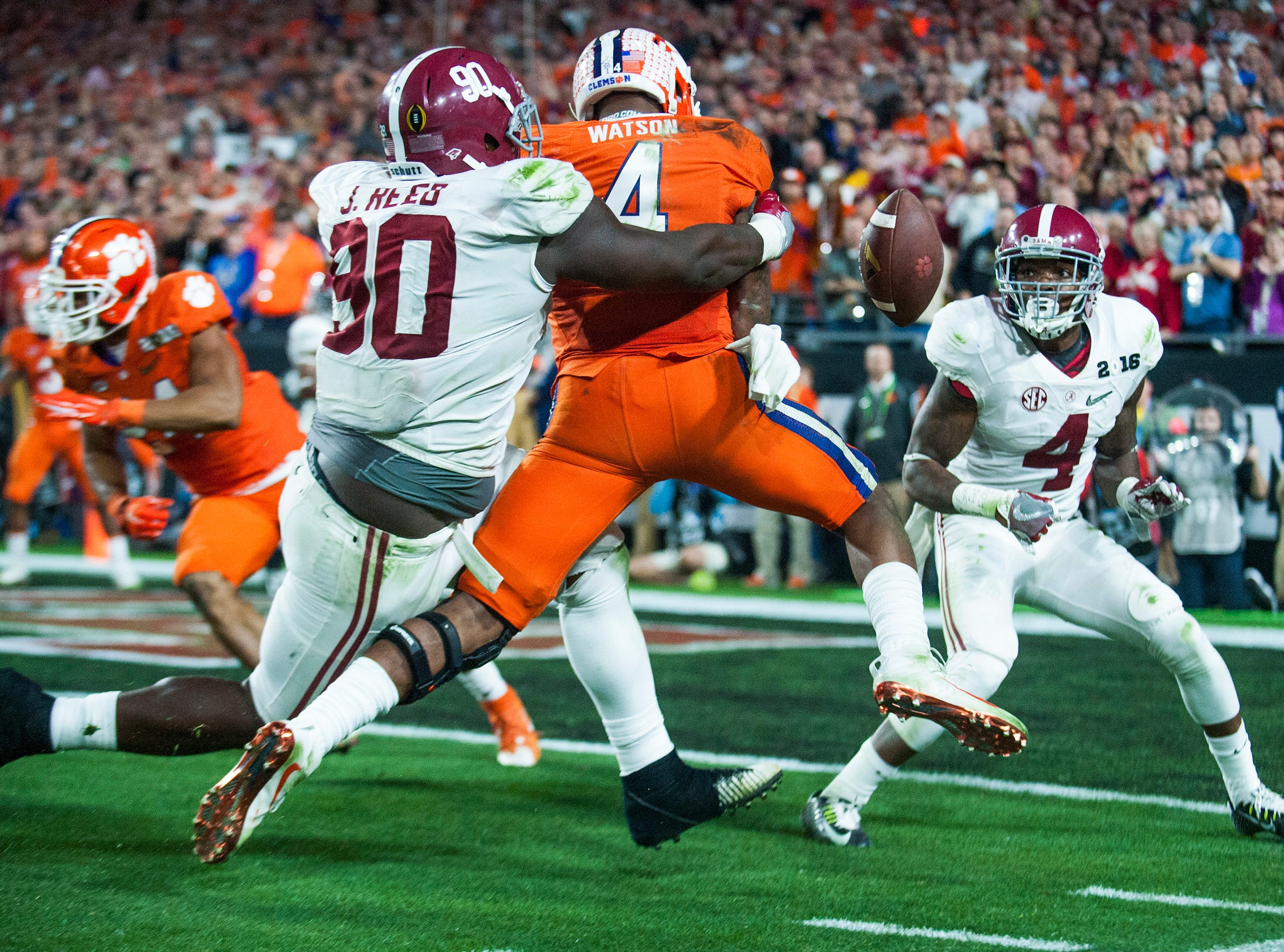 Alabama defensive lineman Jarran Reed (90) stops Clemson quarterback Deshaun Watson (4)  short of the goal line on a two point conversion attempt in the College Football Playoff Championship Game on Monday January 11, 2016 at University of Phoenix Stadium in Glendale, Az.