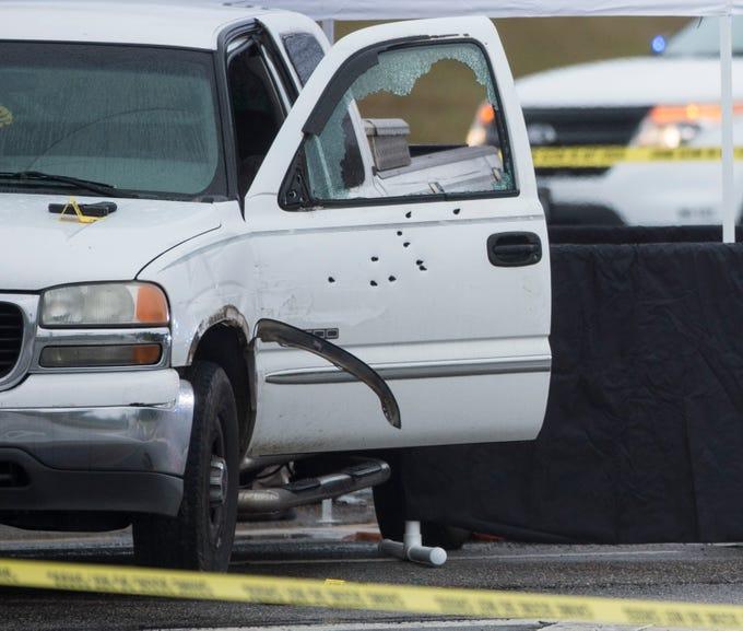 Emergency crews investigate a stolen car chase on Highway 14 near Interstate 65 in Prattville, Ala., on Thursday, Jan. 3, 2019.