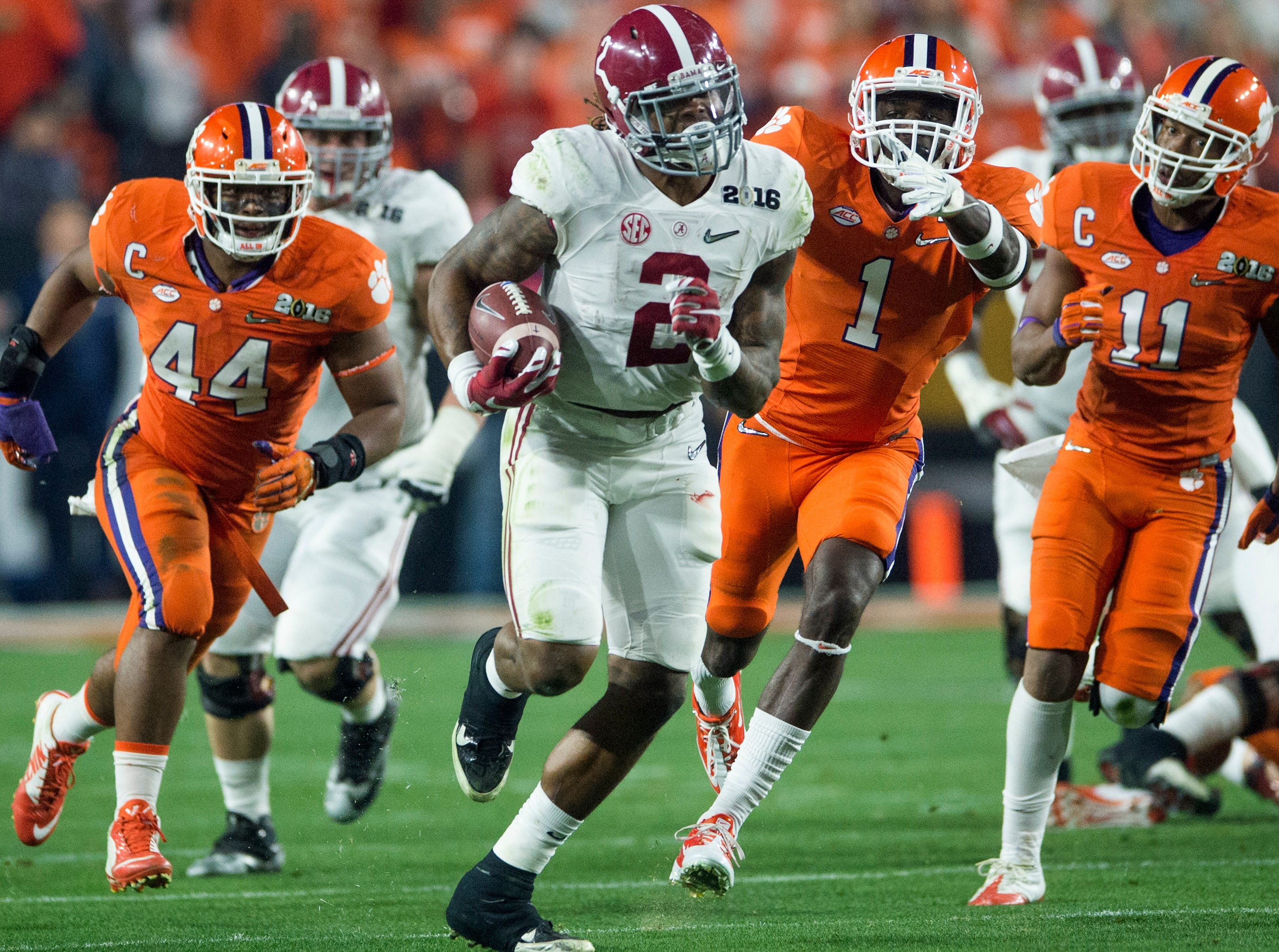 Alabama running back Derrick Henry (2) gets by Clemson safety Jayron Kearse (1) for a long first quarter touchdown in the College Football Playoff Championship Game on Monday January 11, 2016 at University of Phoenix Stadium in Glendale, Az.