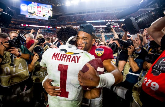 Alabama quarterback Tua Tagovailoa (13) hugs and talks with Oklahoma quarterback Kyler Murray (1) after the Orange Bowl at Hard Rock Stadium in Miami Gardens, Fla., on Saturday December 29, 2018.