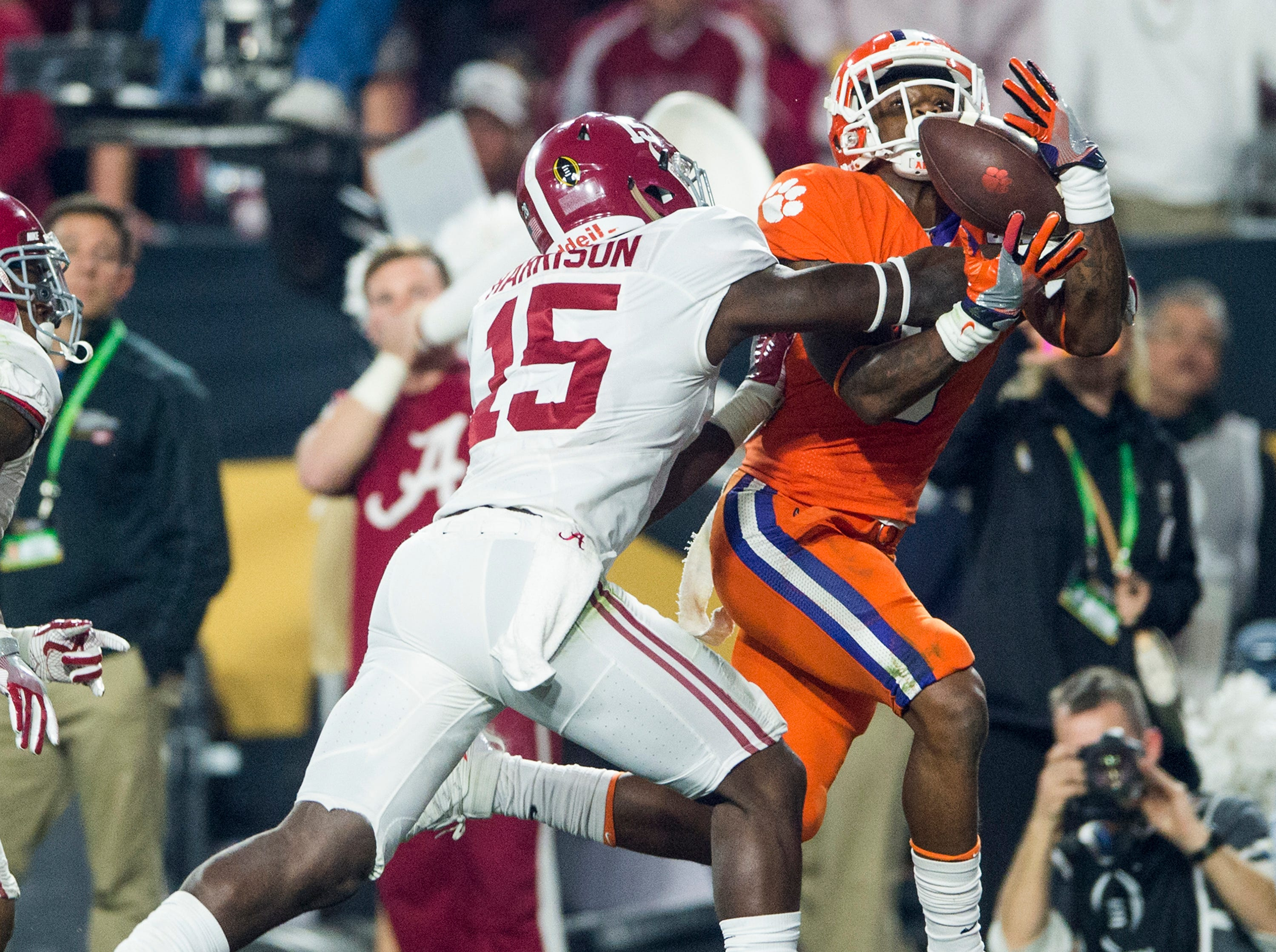 Alabama defensive back Ronnie Harrison (15) breaks up a pass against Clemson wide receiver Artavis Scott (3) in the end zone in the College Football Playoff Championship Game on Monday January 11, 2016 at University of Phoenix Stadium in Glendale, Az.
