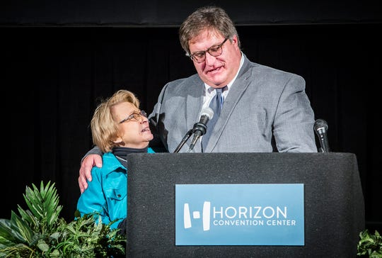 MCS Board President James Williams presents 51-year-veteran teacher Sharon Crain with a gift bag during the teacher Appreciation Luncheon at the Horizon Convention Center Thursday afternoon.