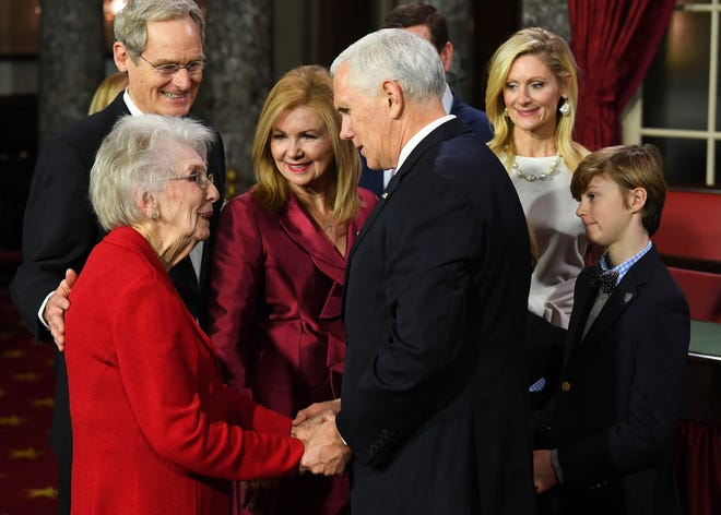 Vice President Mike Pence shaking the hand of Marsha Blackburn's mother Mary Jo Morgan Wedgeworth before he officiates ceremonial swearing-in of Marsha Blackburn in the Old Senate Chambers at the U.S. Capitol as she becomes Tennessee's first female United States Senator.