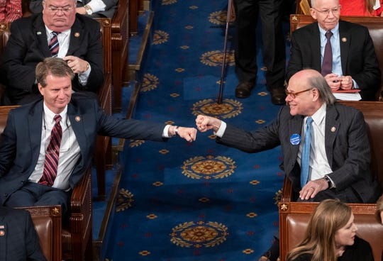 Newly-elected Rep. Tim Burchett, a Tennessee Republican, left, and Rep. Steve Cohen, a Tennessee Democrat, exchange a fist bump from opposite sides of the aisle on the first day of the 116th Congress as the Democrats take the majority from the GOP, at the Capitol in Washington, Thursday, Jan. 3, 2019.