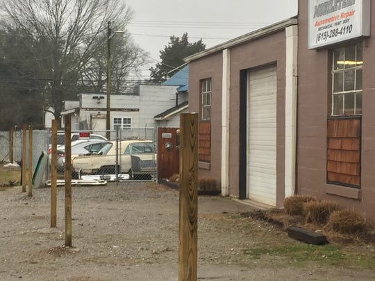 Fence posts installed at the rear of a  North Mt. Juliet Road gas station property, but close enough to potentially limit entrance to the front of Mobiletech Automotive Repair.