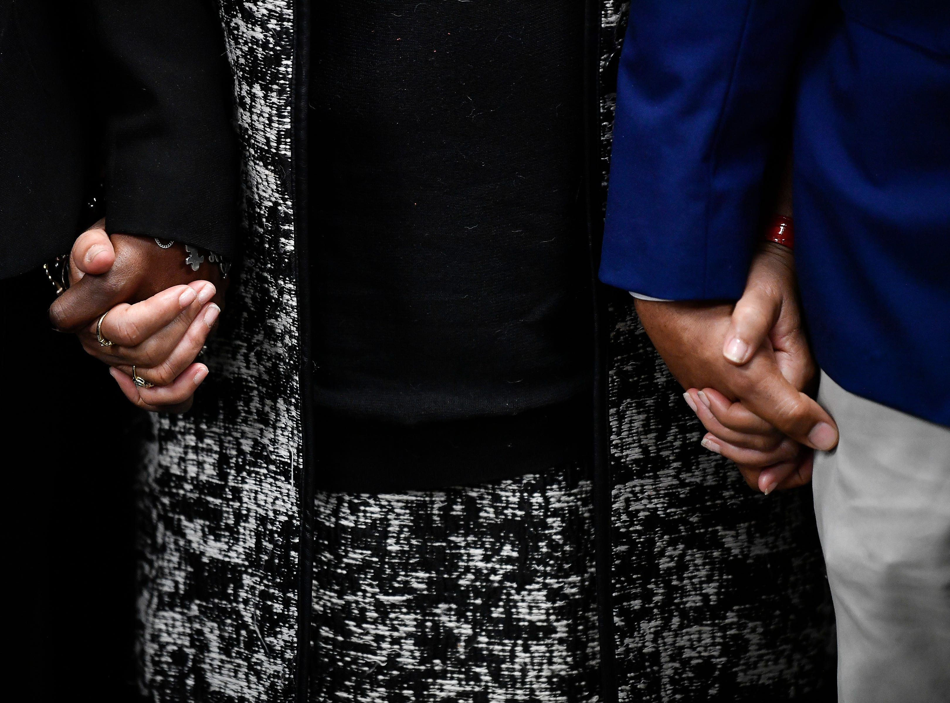 Supporters of Cyntoia Brown hold hands as they pray during a press conference asking Gov. Bill Haslam to grant Cyntoia Brown clemency after being convicted of murder when she was 16-years-old in 2004 at the Cordell Hull Building Thursday, Jan. 3, 2019, in Nashville, Tenn.