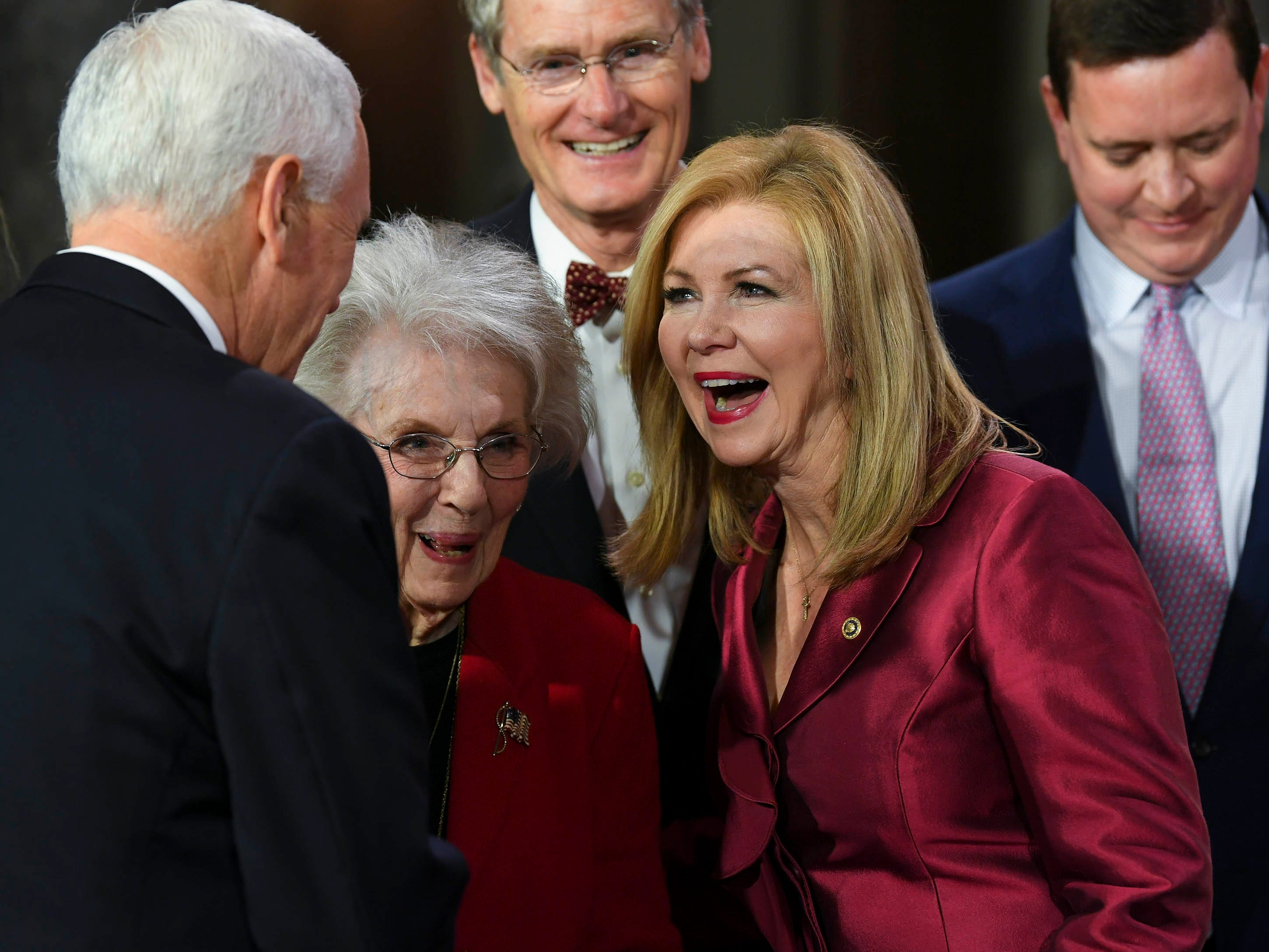 Vice President Mike Pence greets Marsha Blackburn before he officiates the ceremonial swearing-in in the Old Senate Chambers at the U.S. Capitol as she becomes Tennessee's first female United States Senator.