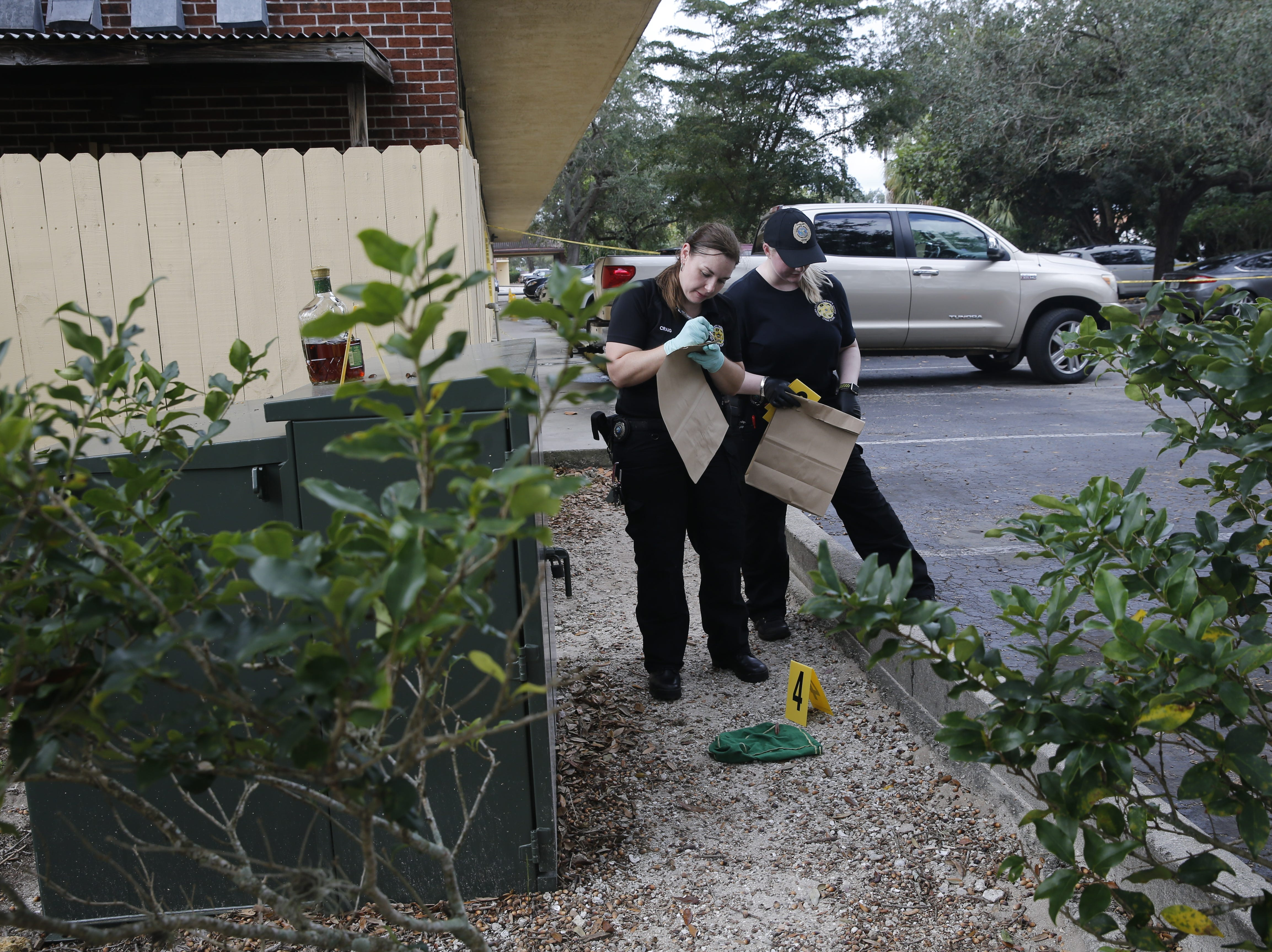 Collier County Sheriff's Office crime scene investigators process evidence at the scene of a homicide, Thursday, Jan. 3, 2019 at a condominium complex in the 4000 block of Golden Gate Parkway near Collier Boulevard.