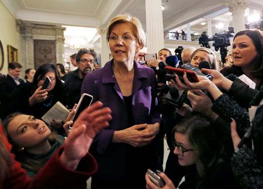 Sen. Elizabeth Warren, D-Mass., is surrounded by reporters at the Massachusetts Statehouse, Wednesday, Jan. 2, 2019, in Boston. Warren took the first major step toward launching a widely anticipated campaign for the presidency in January, hoping her reputation as a populist fighter can help her navigate a Democratic field. (AP Photo/Elise Amendola)