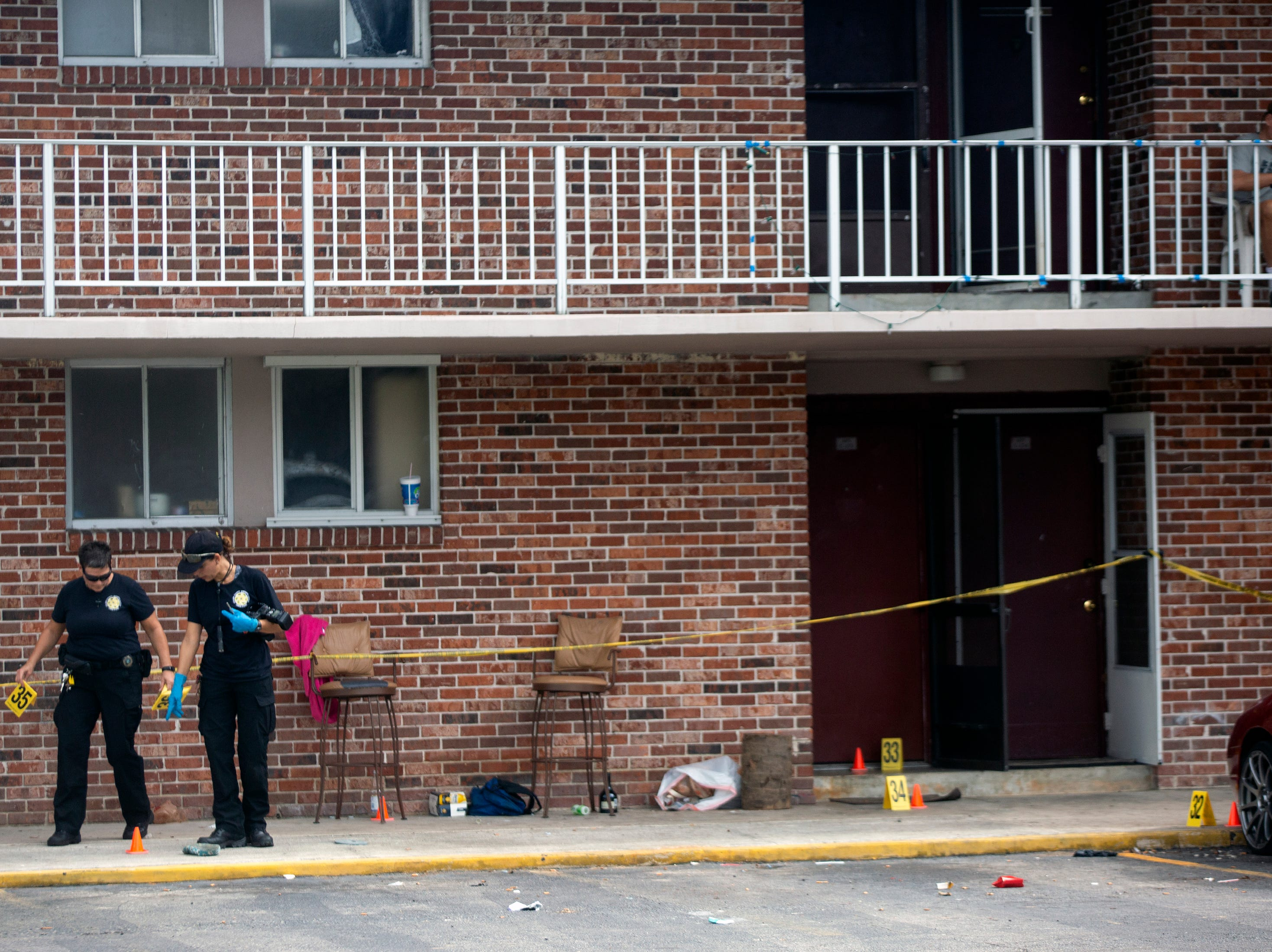 Crime scene investigators with the Collier County Sheriff's Office process evidence Thursday, Jan. 3, 2019, at a condominium complex in the 4000 block of Golden Gate Parkway near Collier Boulevard.