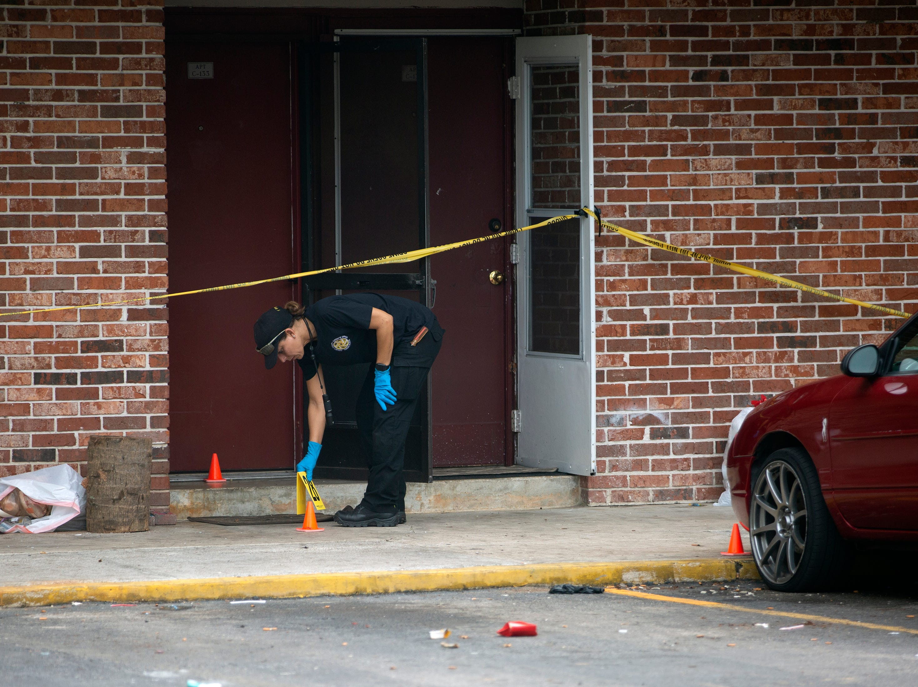 Crime scene investigators with the Collier County Sheriff's Office process evidence Thursday, Jan. 3, 2019 at a condominium complex in the 4000 block of Golden Gate Parkway near Collier Boulevard.