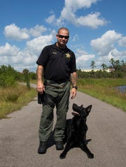 Cpl. Tom Sweeny and his dog, Boss, a retired CCSO K-9, at a park in Naples, Florida, on Monday, Oct. 17, 2016. Boss retired earlier this month after working in the Sheriff's Office for six years. He has been battling an aggressive cancer and is in remission, enjoying the rest of his time with his handler and family.